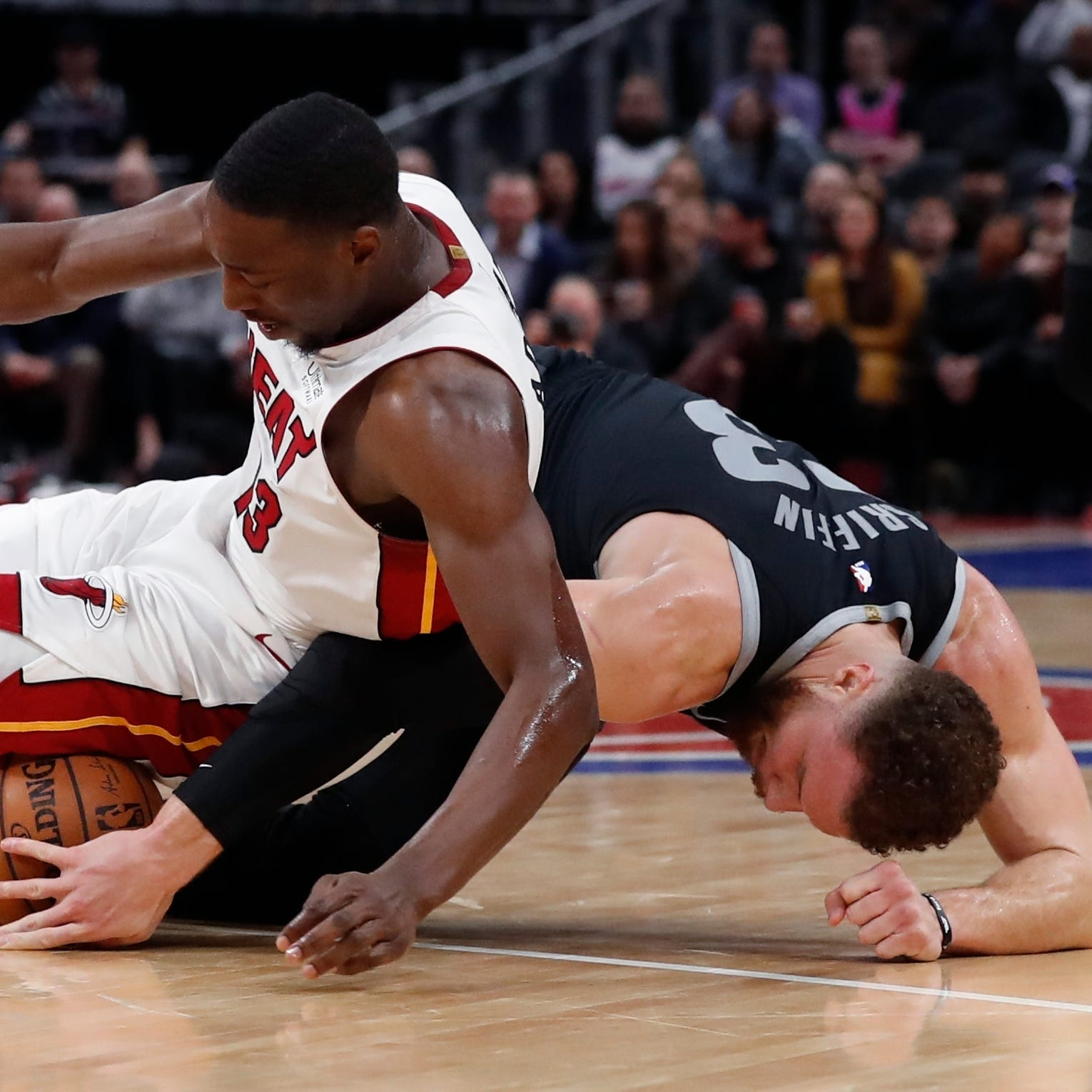 Injury-hampered Pistons tough out a victory over Heat