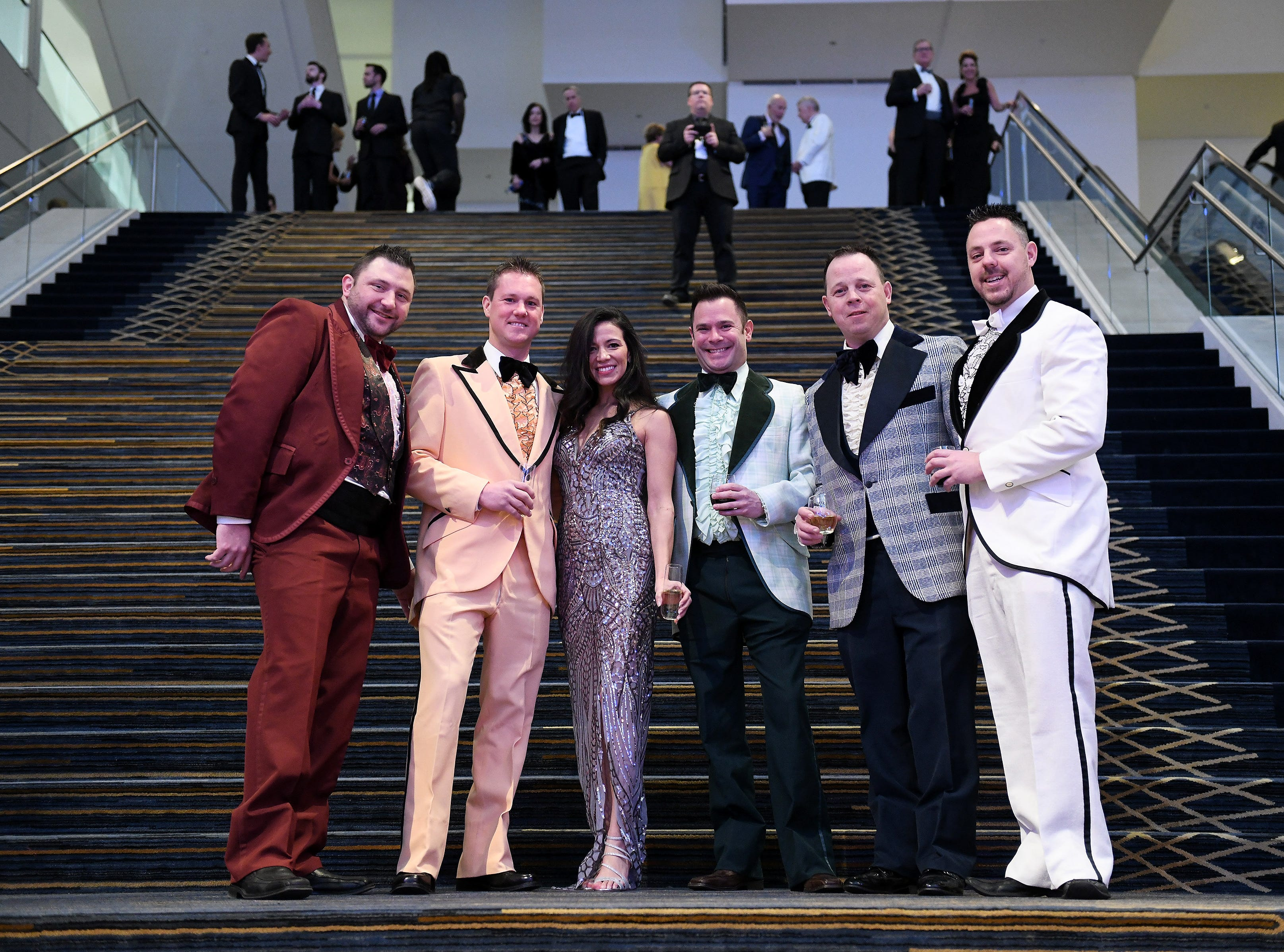 From left, Stephen Mahoney of Clinton Township, Mike and Laine Siemen of Macomb, Joe Cianciolo of Clinton Township, Gene Gunnery of Kimball Township and Brent Pretzer of Clinton Township (Gene Gunnery owns Now and Then Formal Wear) pose for a group photo at the Charity Preview.