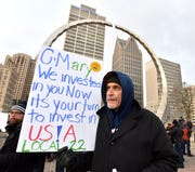 "UAW Local 22, Detroit-Hamtramck Assembly plant electrician Paul Meszaros, of Dearborn, says, 'We'll work for heat right now,"" as he joins others at a candlelight vigil at Hart Plaza, Friday evening, January 18, 2019. UAW and Canadian Unifor workers protest the projected closings of GM plants."