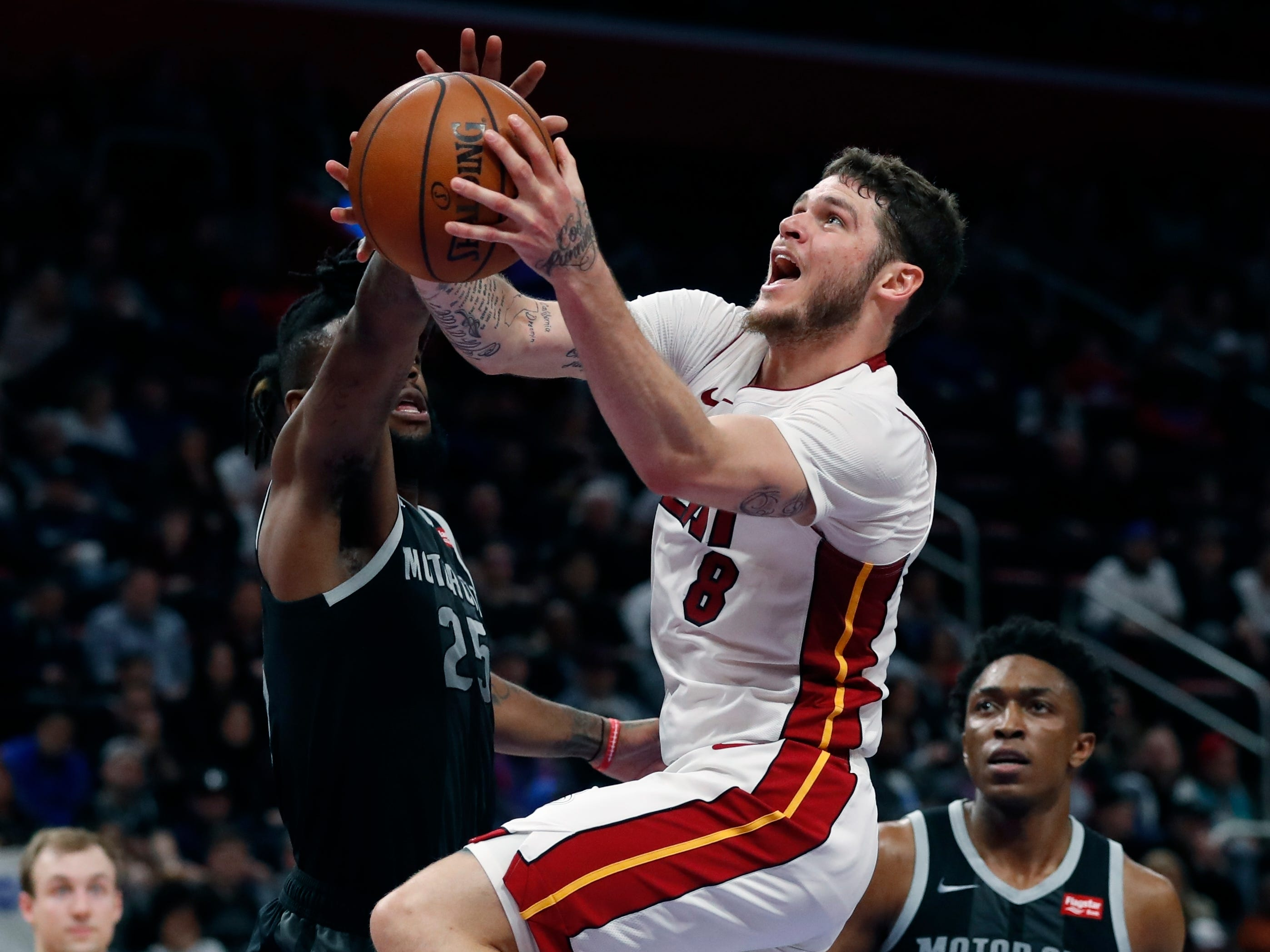Miami Heat guard Tyler Johnson (8) makes a layup as Detroit Pistons guard Reggie Bullock (25) defends during the second half.