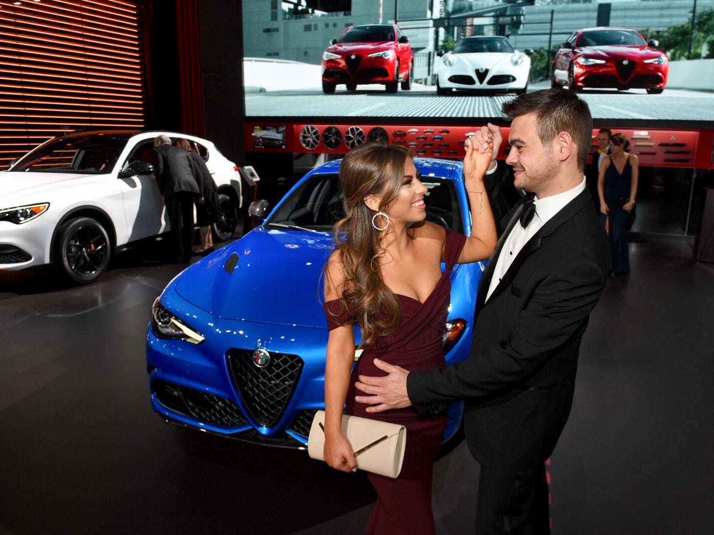 Adriana Francavilla and Antonio Ruggirello of Northville share a dance in front of an Alfa Romeo Giulia during the Charity Preview gala at the Detroit auto show at Cobo Center in Detroit on Friday, Jan. 18, 2019.