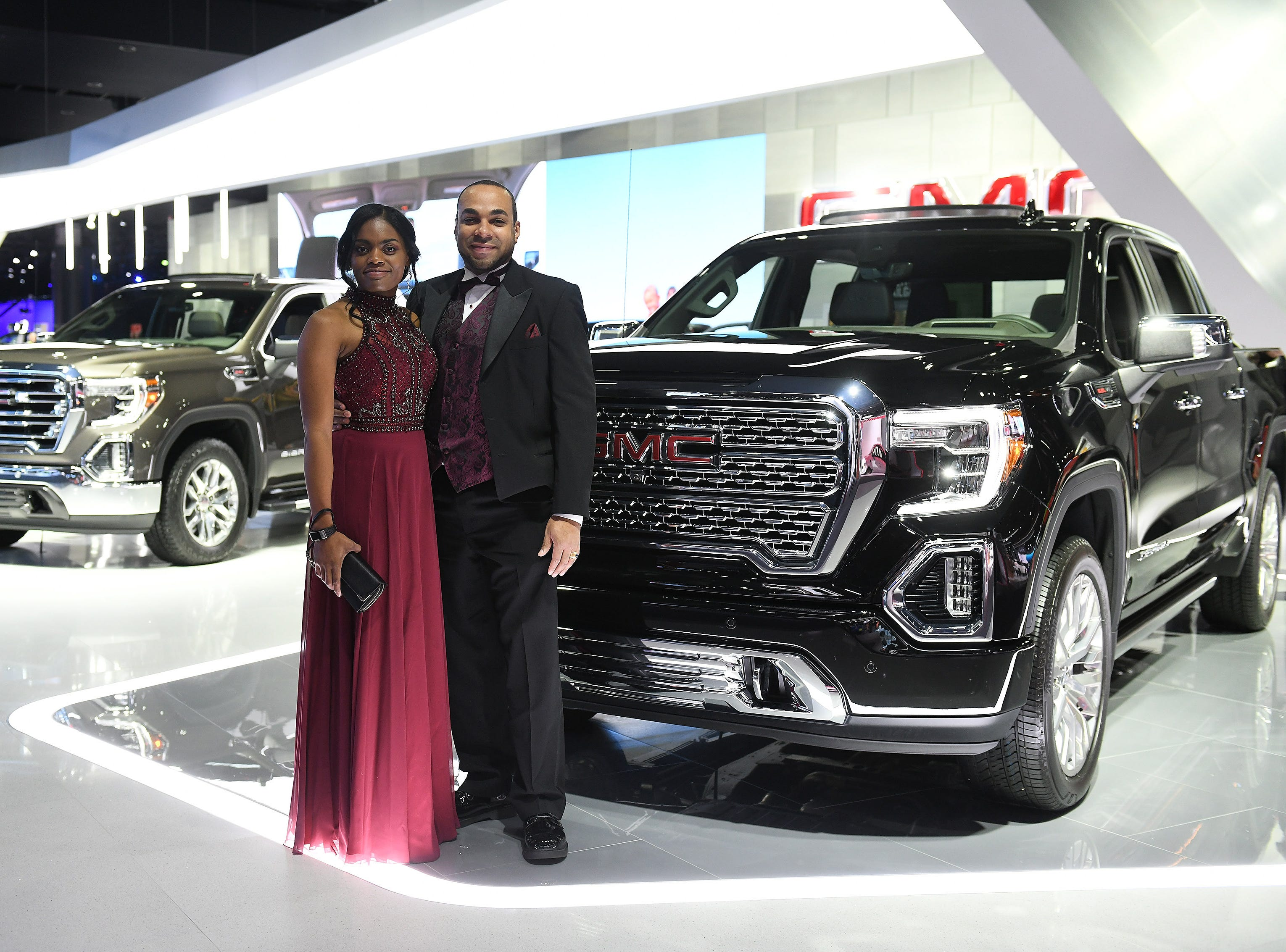Andrew Hester, GM engineer, of Troy and Andrea Micou at the GMC display at the Charity Preview.