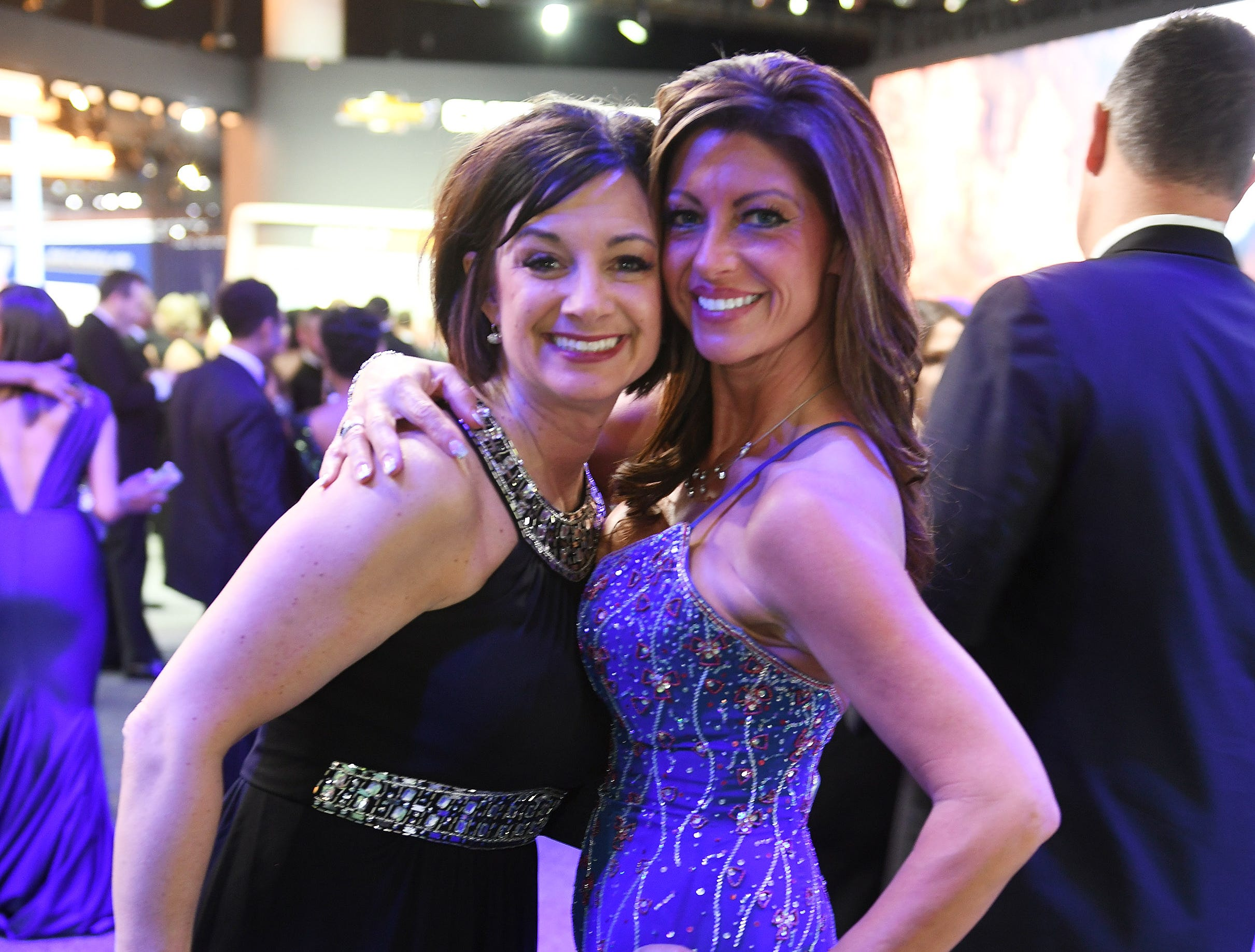 Bobbi Jo Lucas of Howell and Jennifer Kaluza of Trenton, right, smile for the camera at the Ford exhibit.