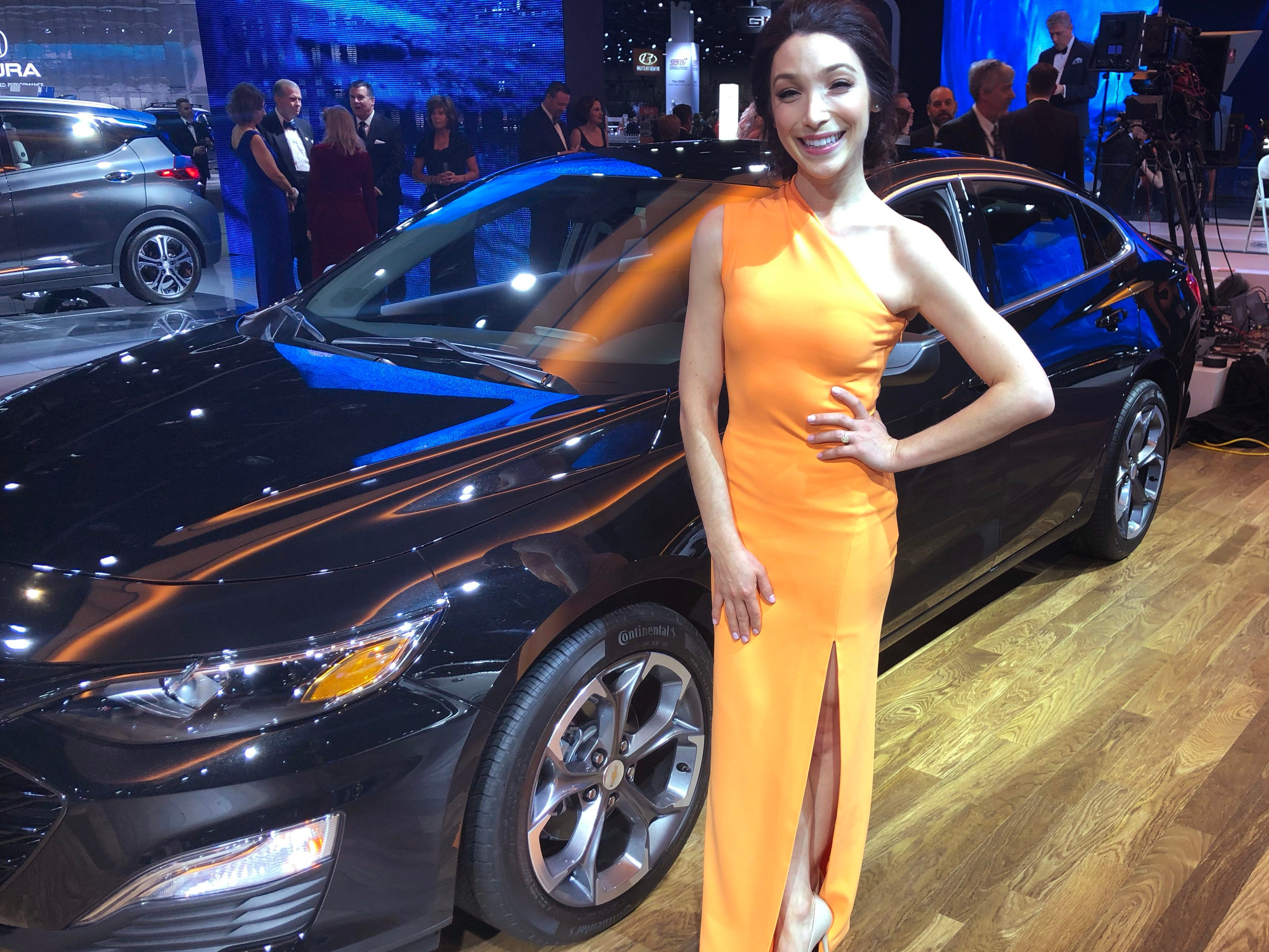 Olympic Champion figure skater Meryl Davis was looking bright in an apricot, one-shoulder gown with a slit. The Michigan native said she was excited and honored to be at the Charity Preview, and a little embarrassed to say it was her first time at the auto show.