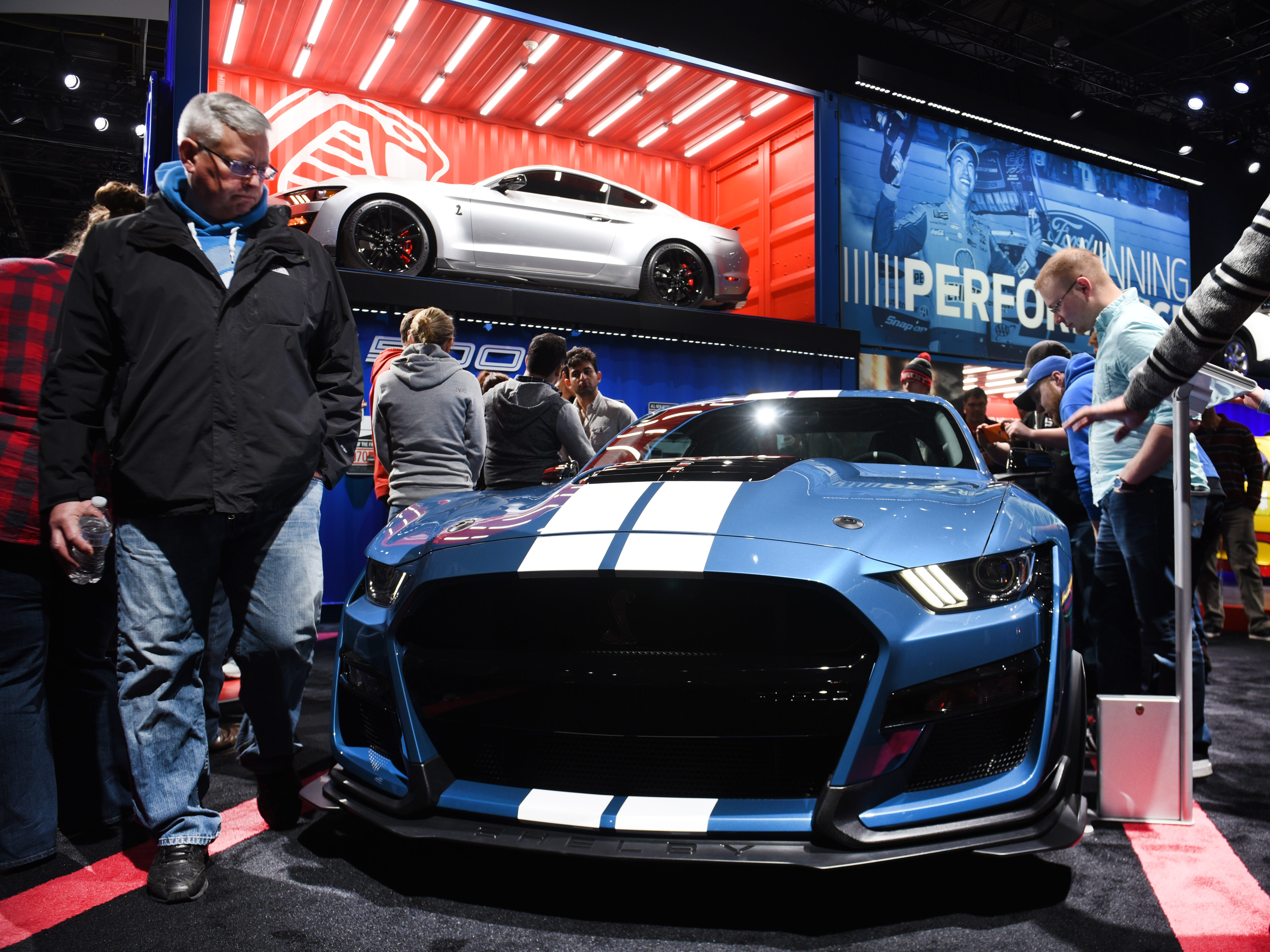 People admire the 2020 Ford Mustang Shelby GT500 at Cobo Center for the 2019 North American International Auto Show.