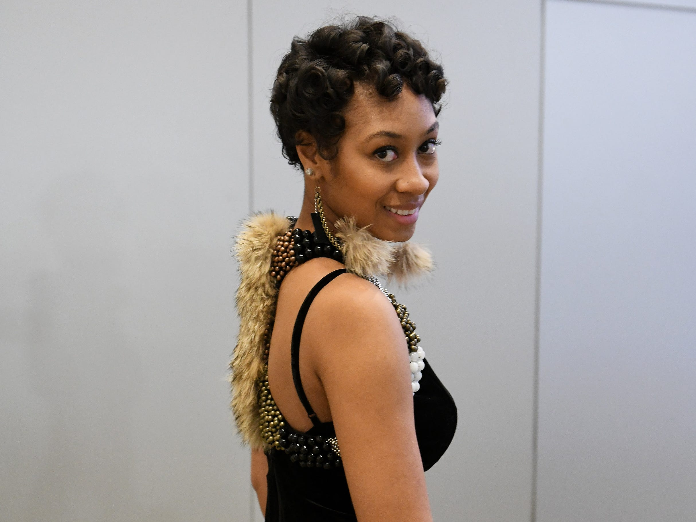 Melisa Taylor of Detroit made the dress decor from precious stones and fresh pearls and earrings herself. Her company is Nishati Ura.