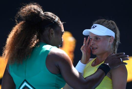 United States' Serena Williams consoles Ukraine's Dayana Yastremska after winning their third round match at the Australian Open tennis championships.
