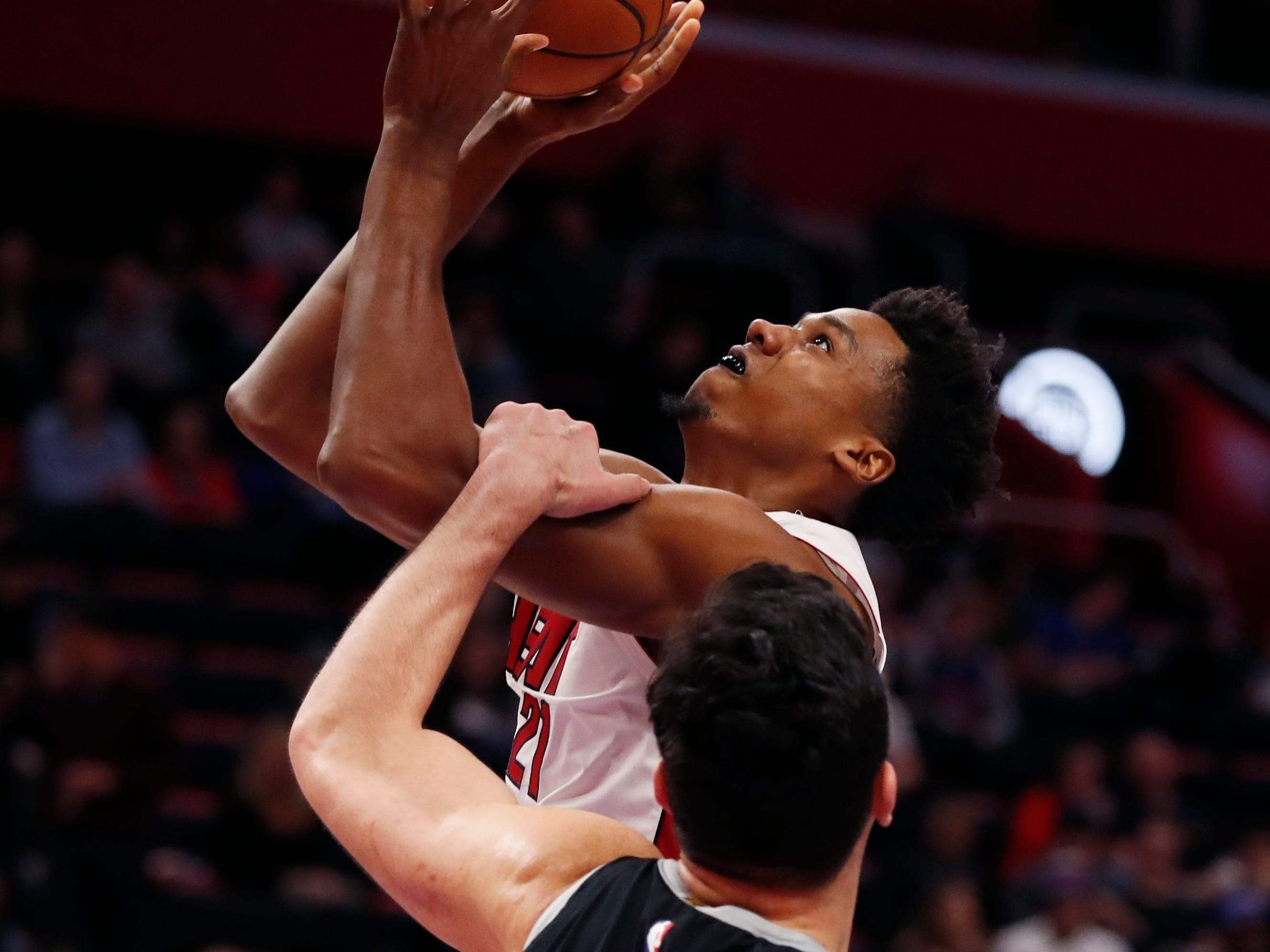 Miami Heat center Hassan Whiteside (21) is fouled by Detroit Pistons center Zaza Pachulia (27) during the second half.