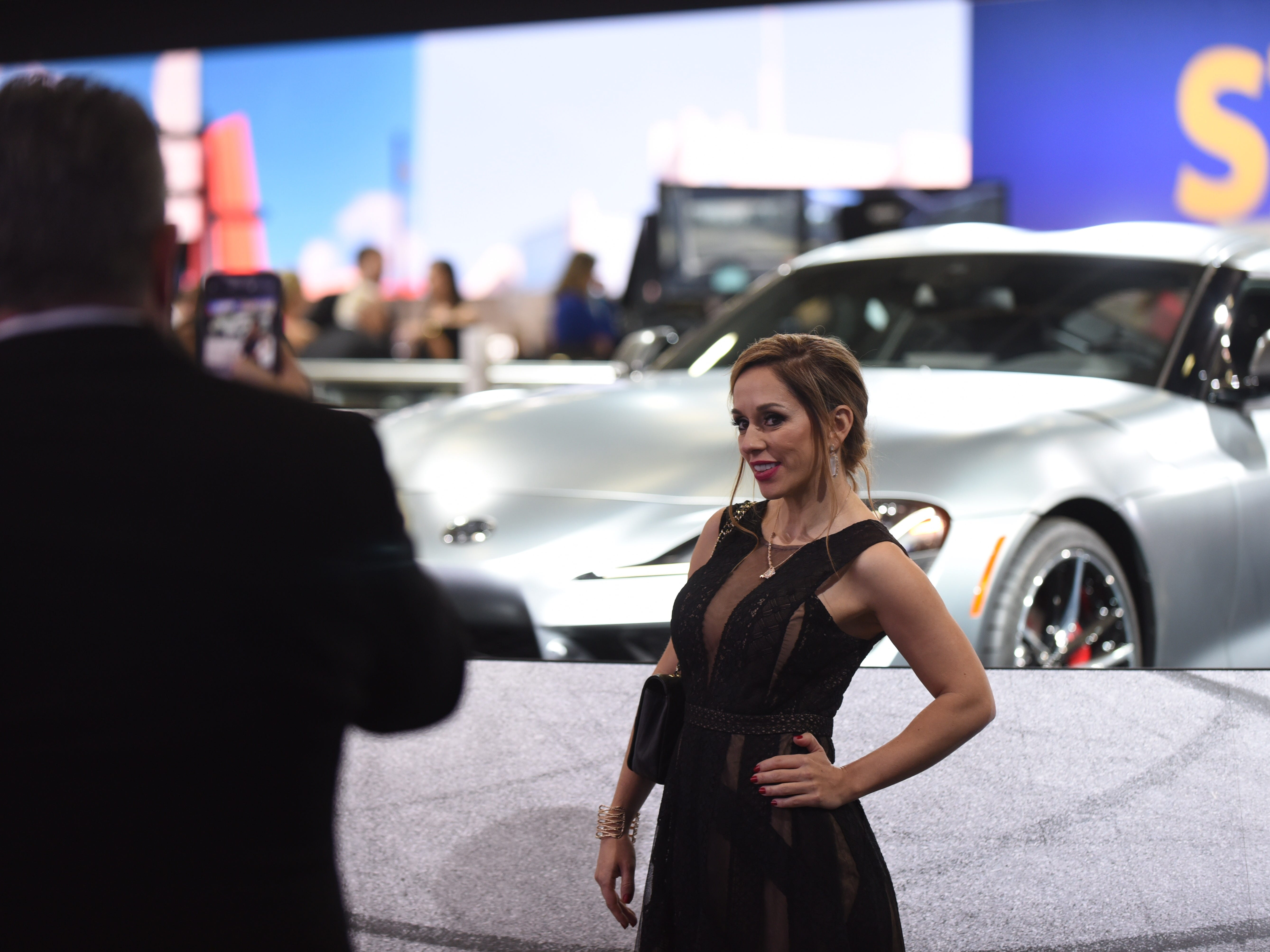 Natila Fraze poses at the Toyota Supra display.