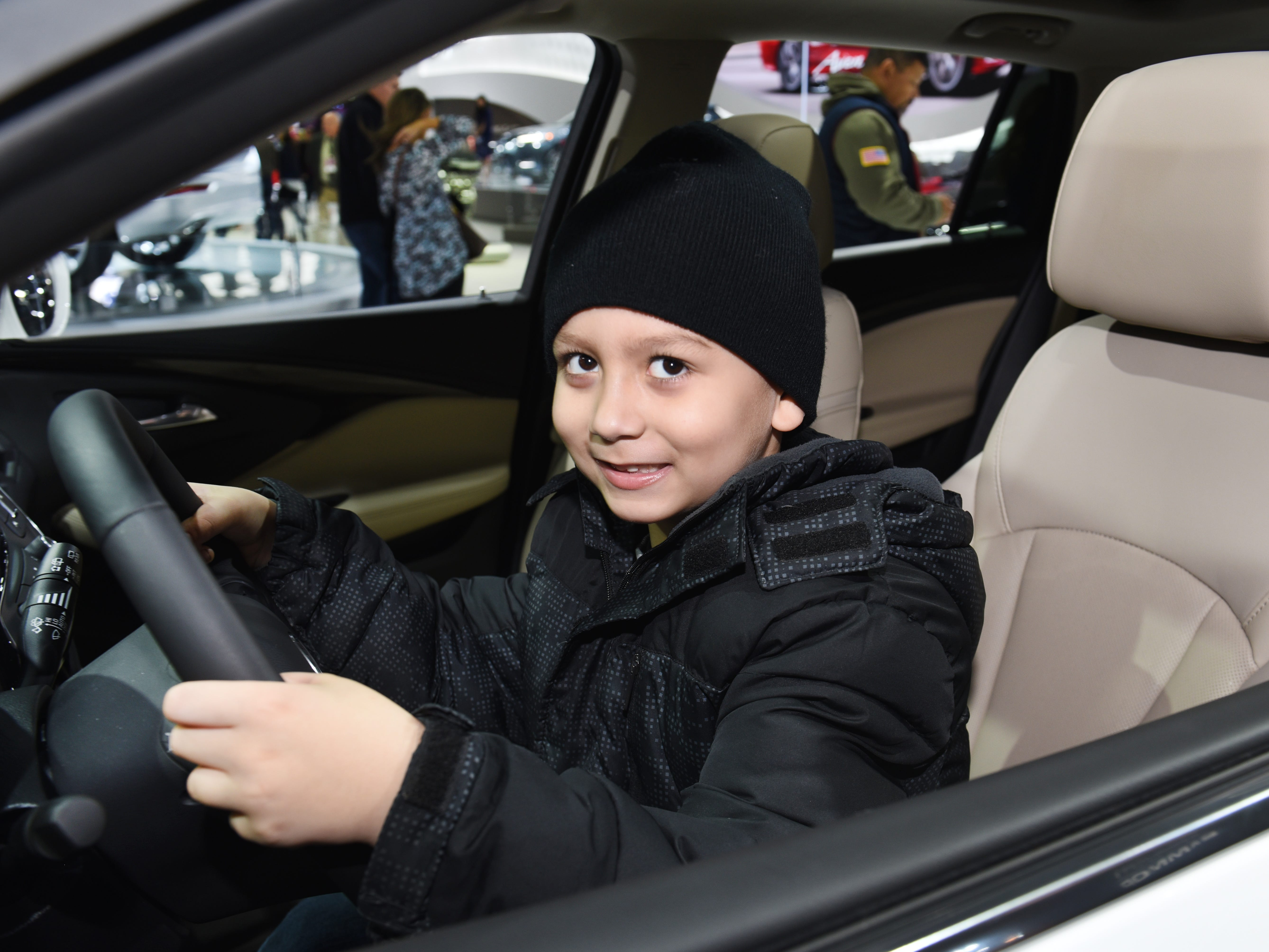 Stefin McLean, 6, of Ann Arbor, sits in the drivers seat of the  2019 Buick Envison at Cobo Center  on Saturday, January 19, 2019.
