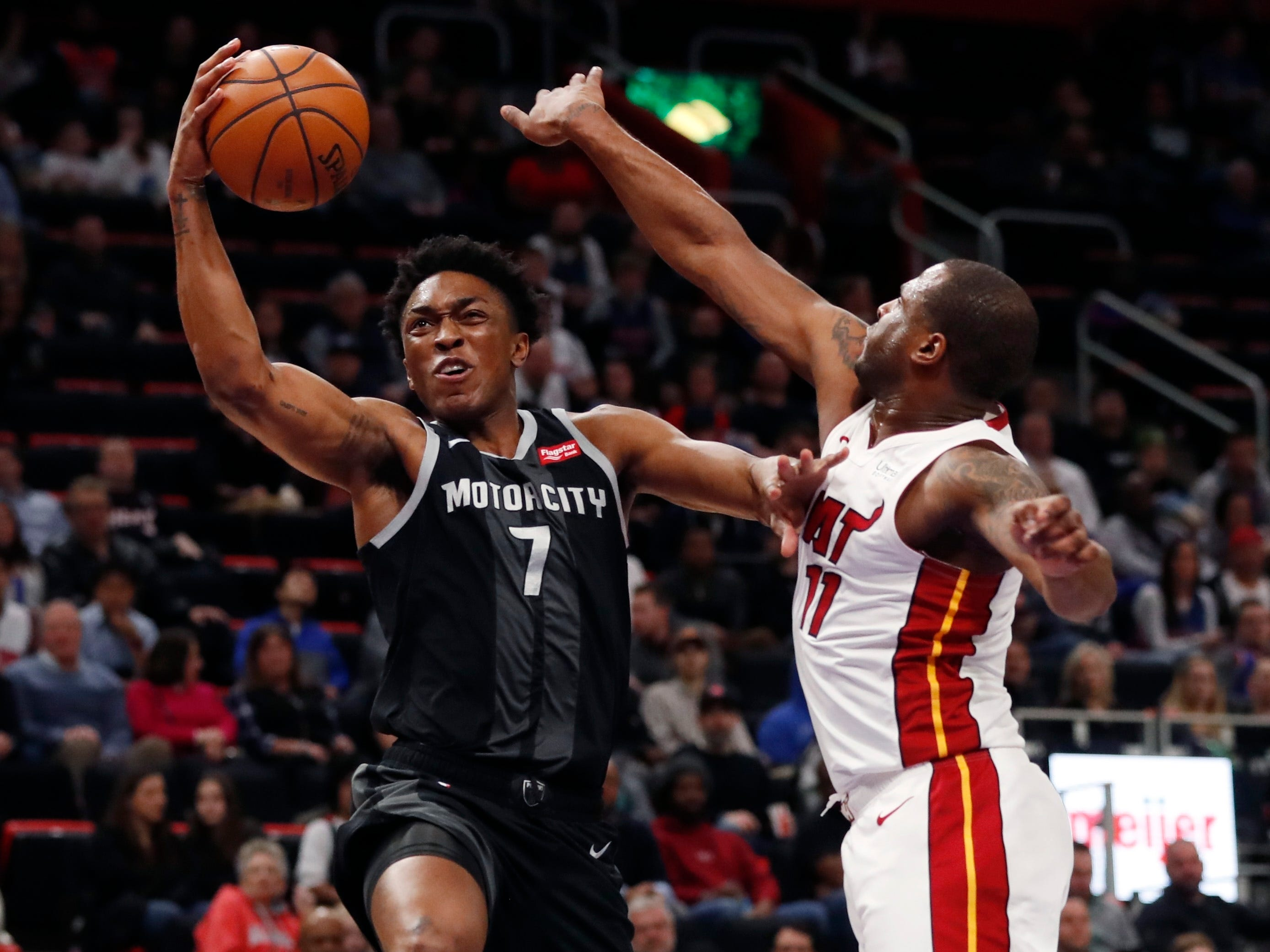 Detroit Pistons forward Stanley Johnson (7) makes a layup as Miami Heat guard Dion Waiters (11) defends during the first half.