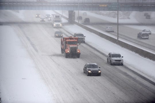 In Metro Detroit, many motorists were drivingwell below posted speed limits along freeways due to slushy conditions.