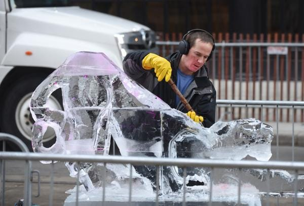 Jess Parrish, ice craver, works on one of the many massive ice sculptures located in the Ice Garden during the Meridian Winter Blast held at Campus Martius on Friday January 26, 2018.