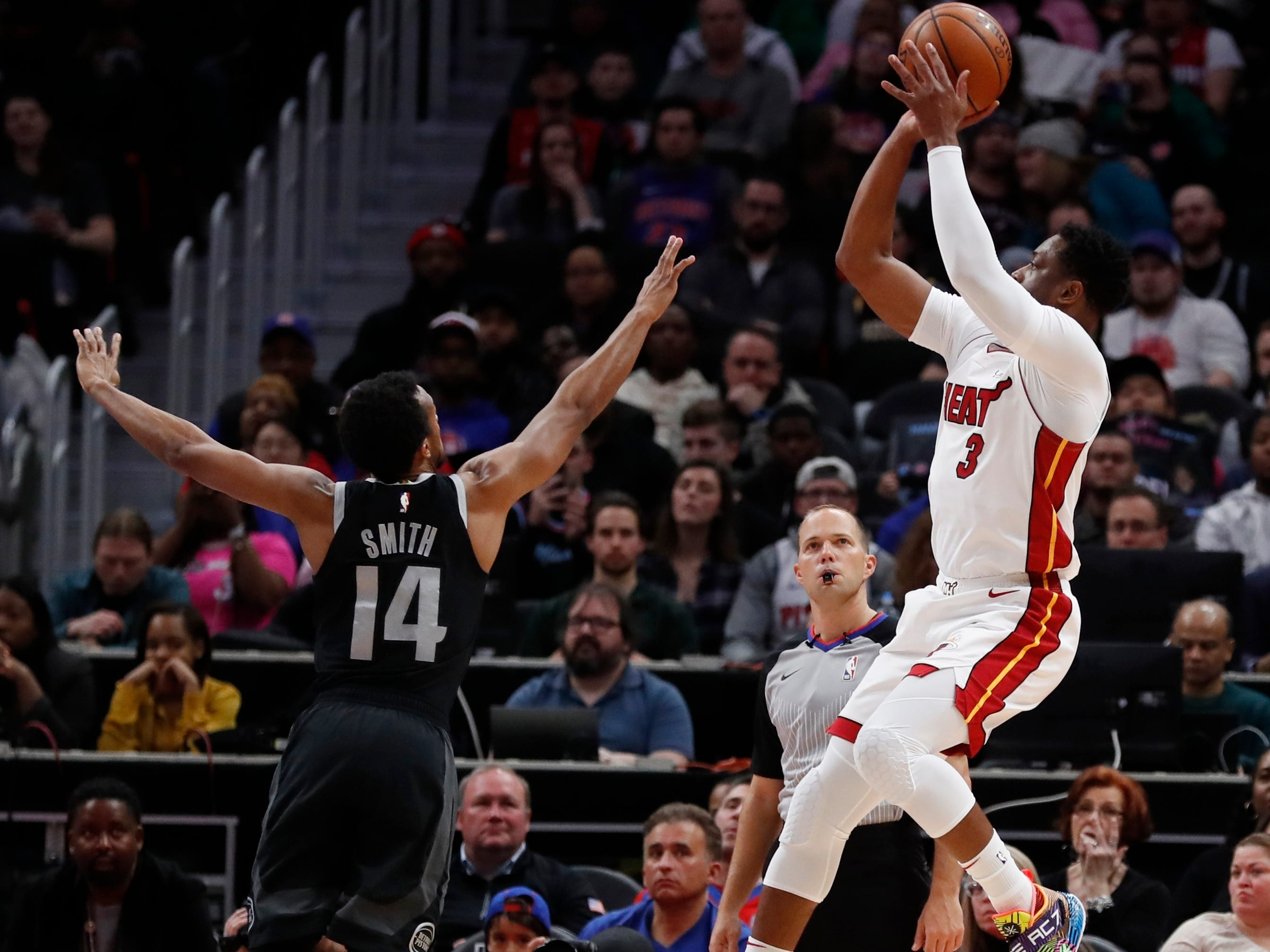 Miami Heat guard Dwyane Wade (3) shoots as Detroit Pistons guard Ish Smith (14) defends during the first half.