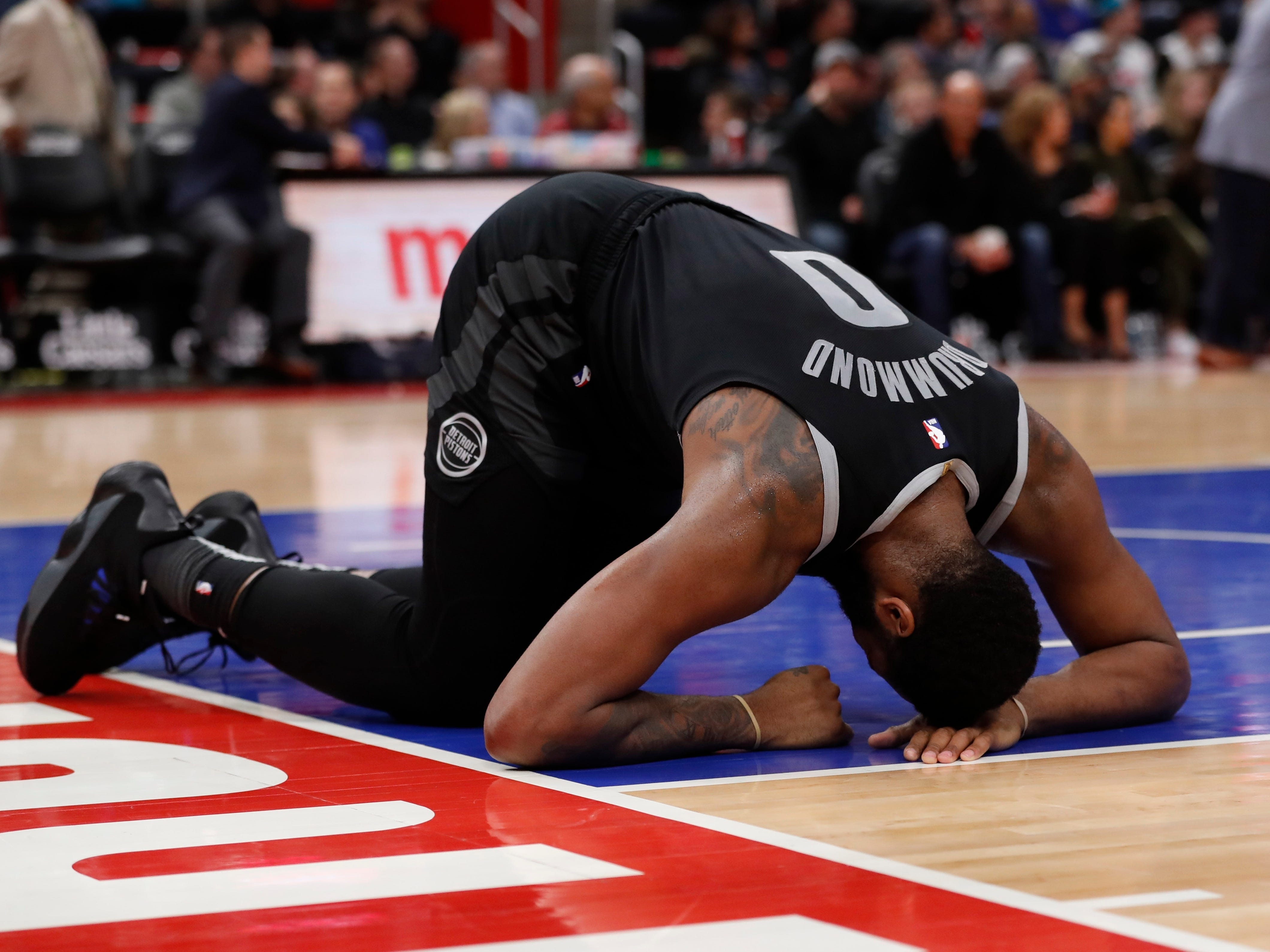 Detroit Pistons center Andre Drummond recovers from a hit to the face during the first half.