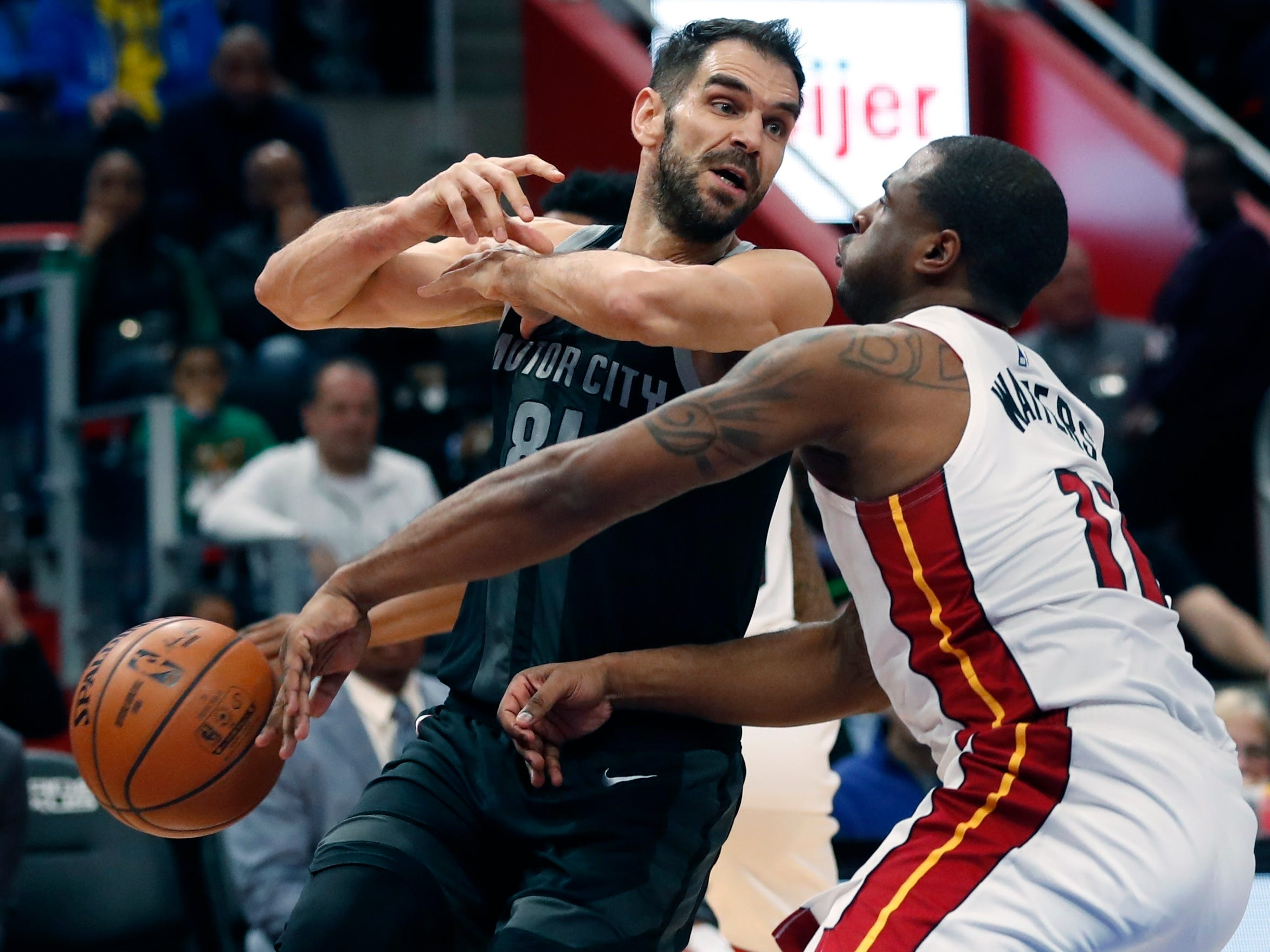 Miami Heat guard Dion Waiters (11) knocks the ball away from Detroit Pistons guard Jose Calderon (81) during the first half.