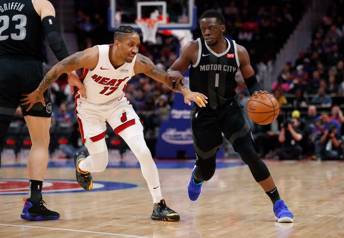 Detroit Pistons guard Reggie Jackson (1) drives around Miami Heat forward Rodney McGruder (17) during the first half of their game, Friday, Jan. 18, 2019, at Little Caesars Arena in Detroit. The Pistons win, 98 to 93.