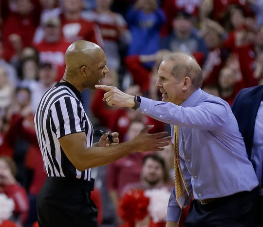 Michigan head coach John Beilein, right, argues a technical foul call during the final seconds of the Jan. 19 game.