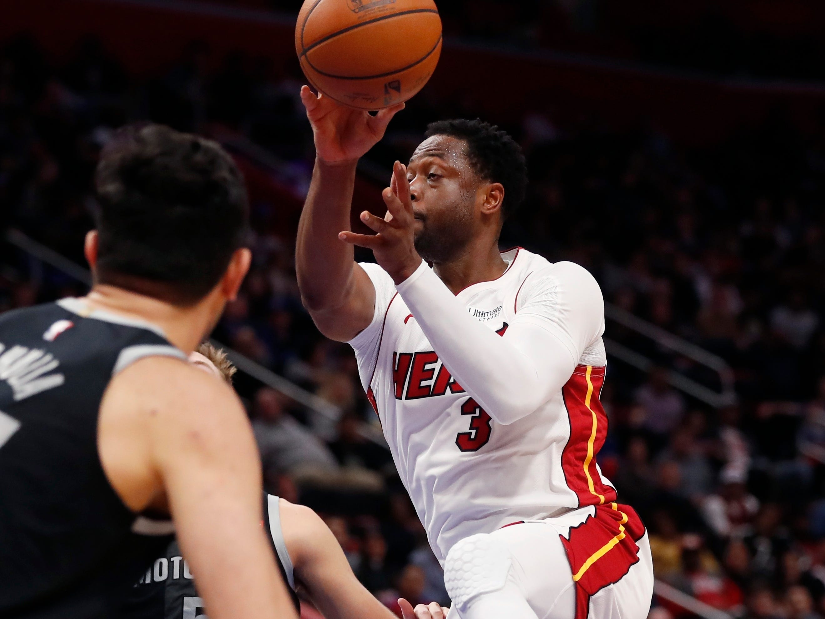 Miami Heat guard Dwyane Wade passes during the second half.
