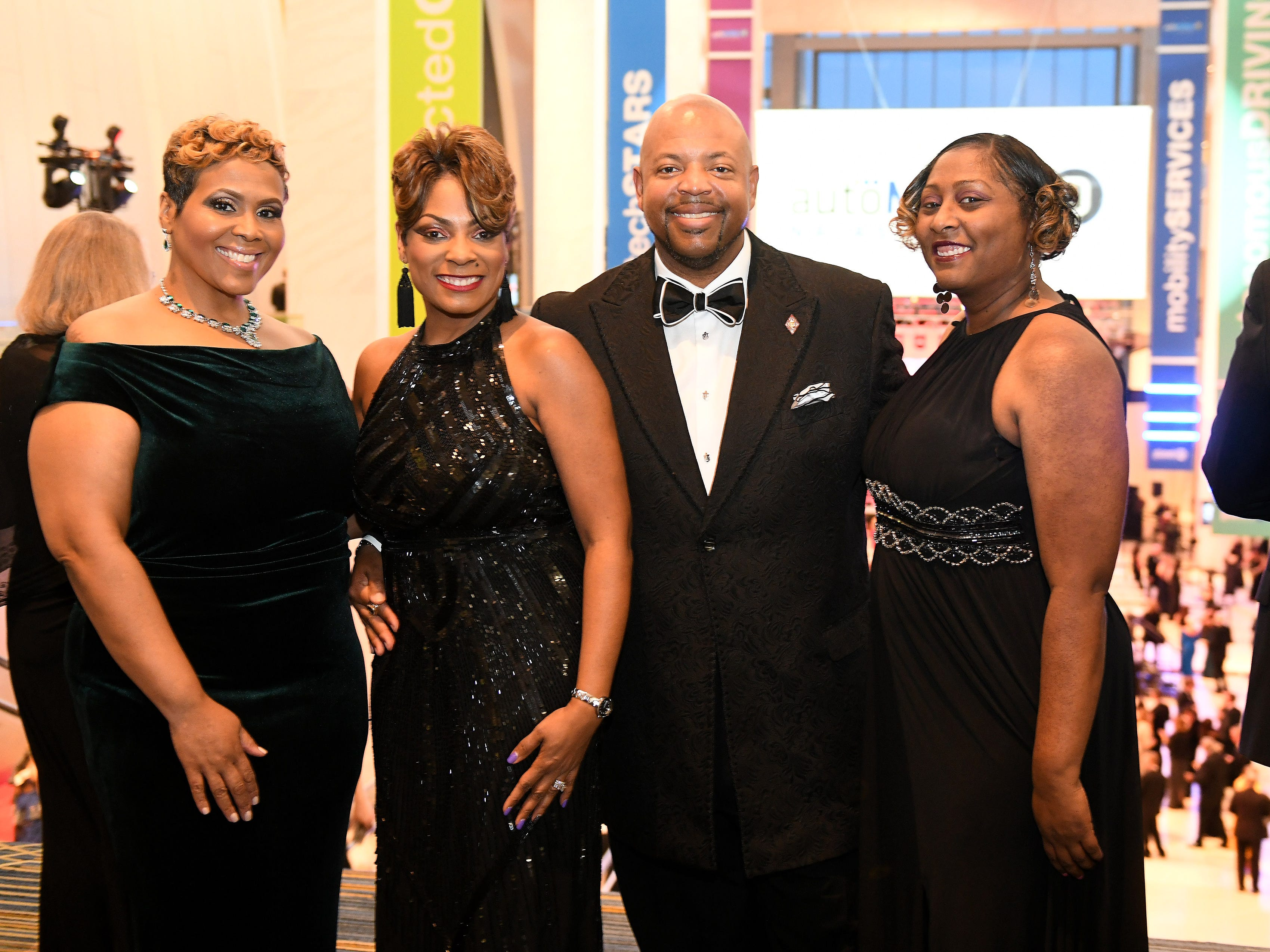 From left, Robyn Robinson of Bloomfield Hills, Samantha Hampton and Melvin Hampton of Westland and Monica Smith of Southfield, at the Charity Preview.