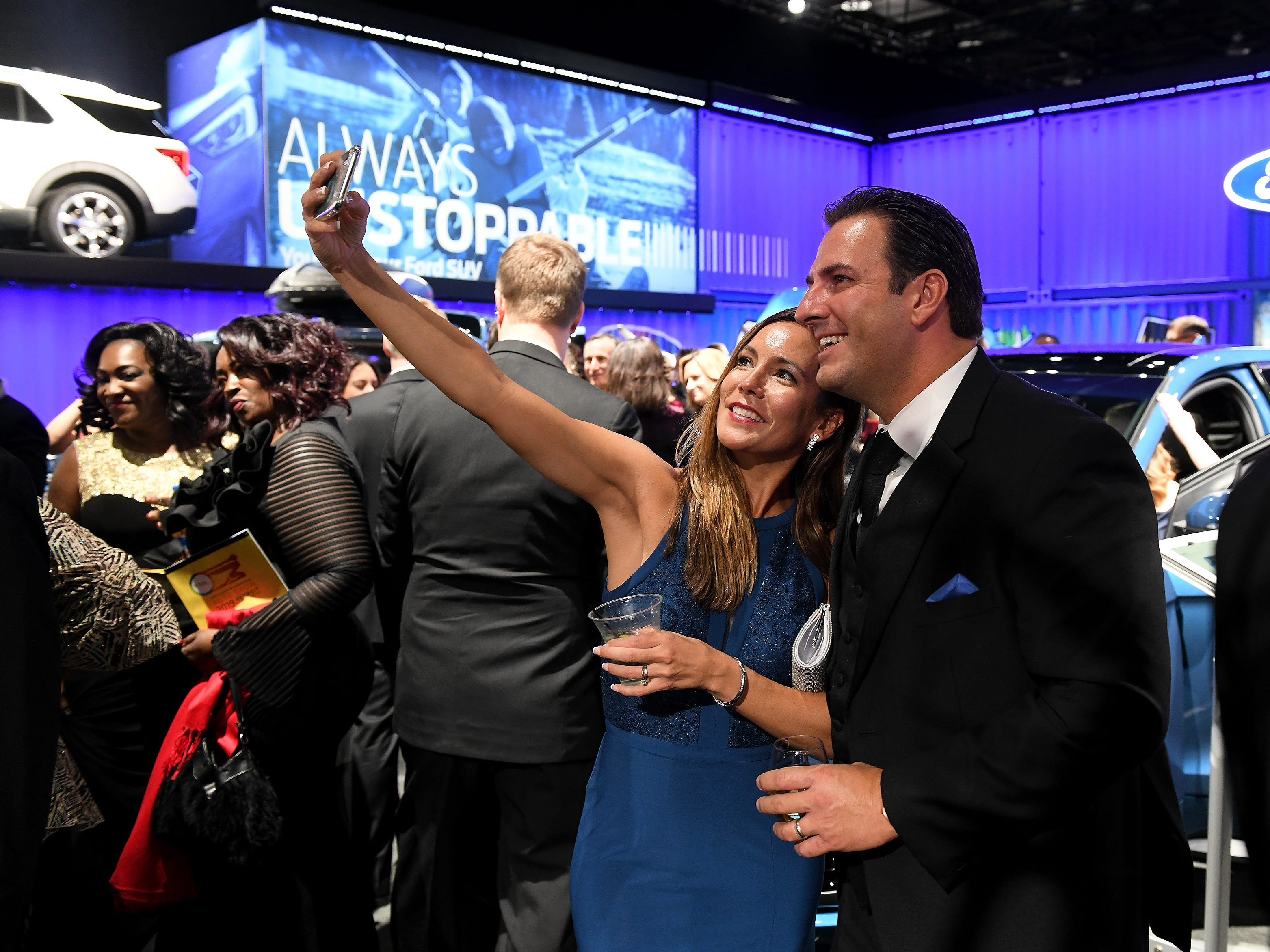 Andrea Szuper takes a selfie with her husband, Stephen Szuper, both of Canton at the Ford display at the Charity Preview.
