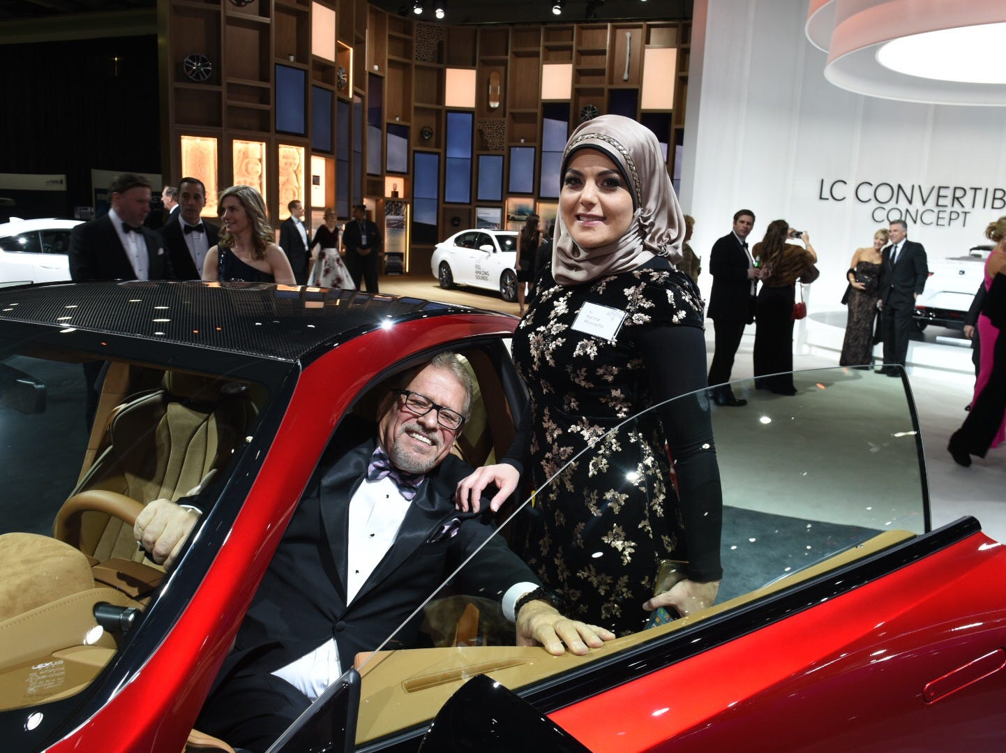 Fouad Ashkar and Fatima Mustapha of Dearborn try out the Lexus LC 500 during the 2019 Charity Preview.