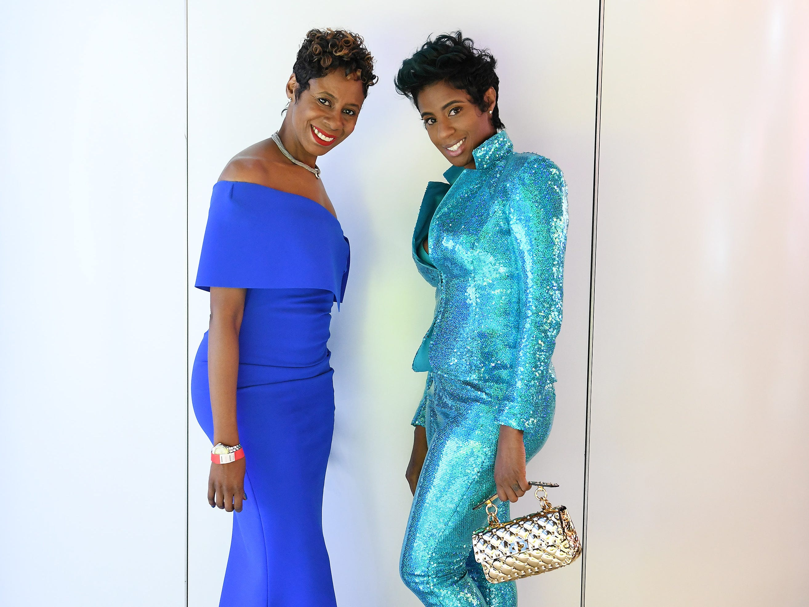 Attorney Tanisha Davis, left, and her cousin, Felicia Turner of Shelby Township, are dressed to dazzle at the auto show's Charity Preview.