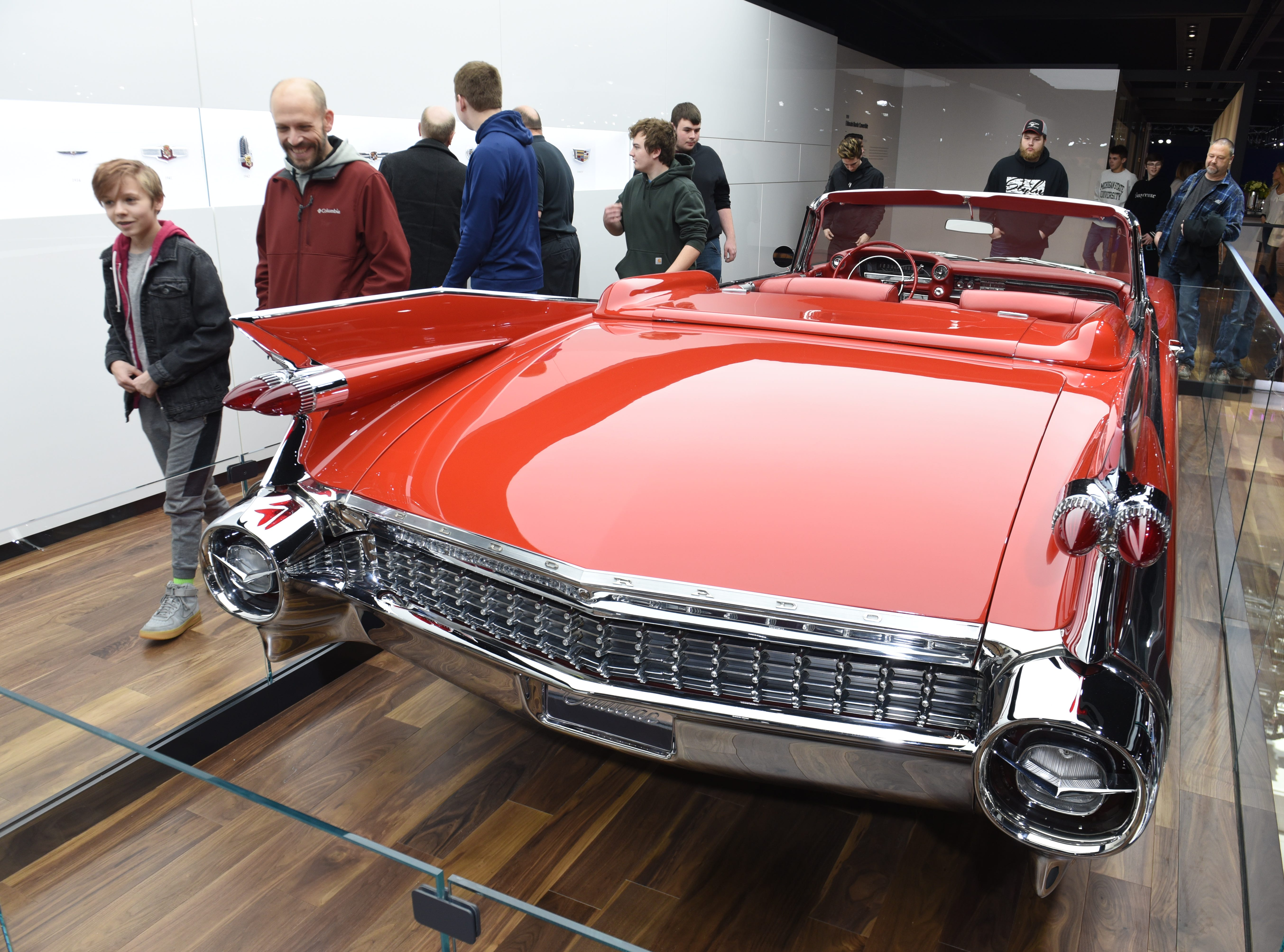 People admire the 1959 Cadillac Eldorado Biarritz Convertible at Cobo Center for the 2019 North American International Auto Show on Saturday, January 19, 2019.