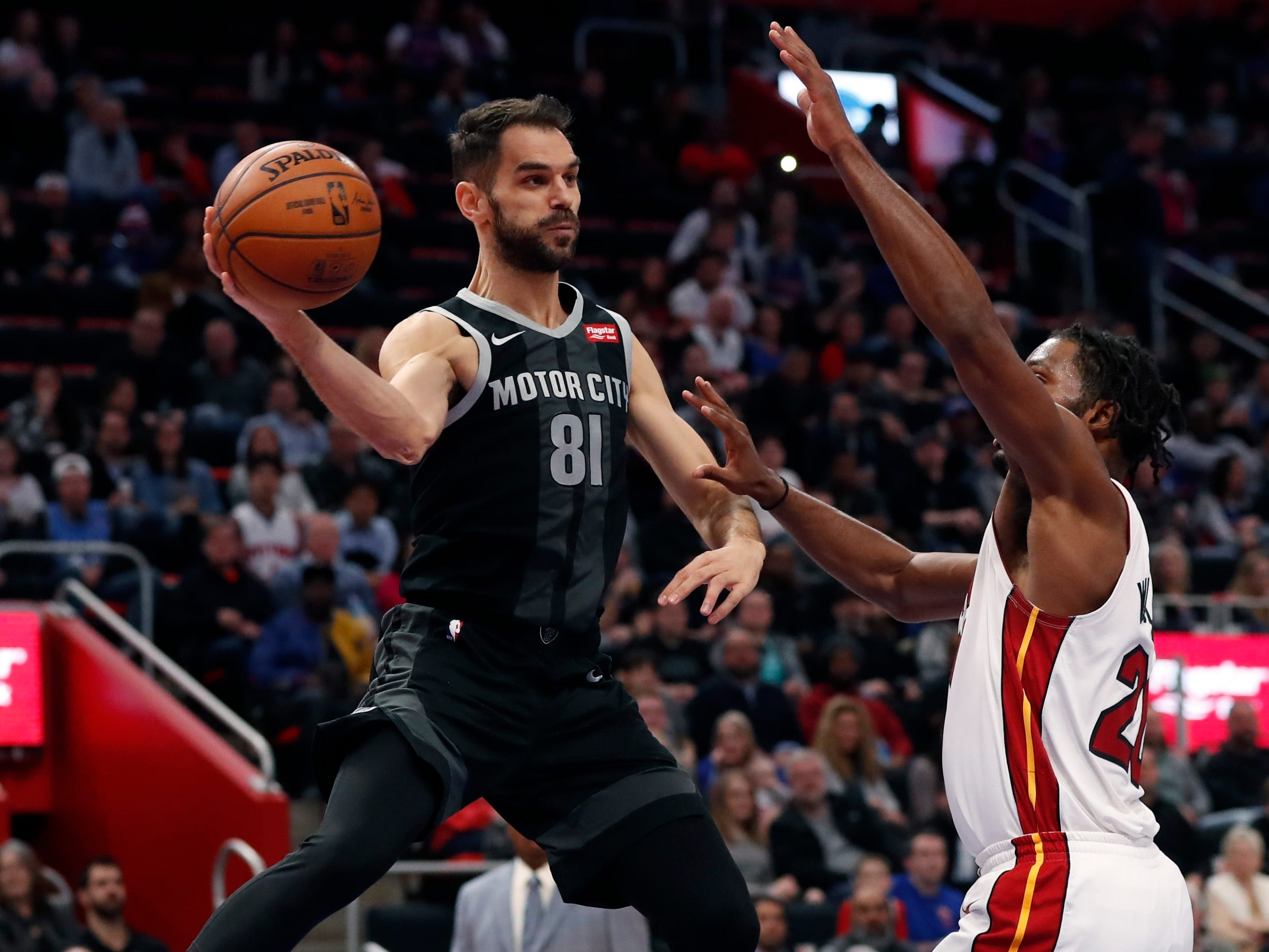 Detroit Pistons guard Jose Calderon (81) passes as Miami Heat forward Justise Winslow defends during the first half.