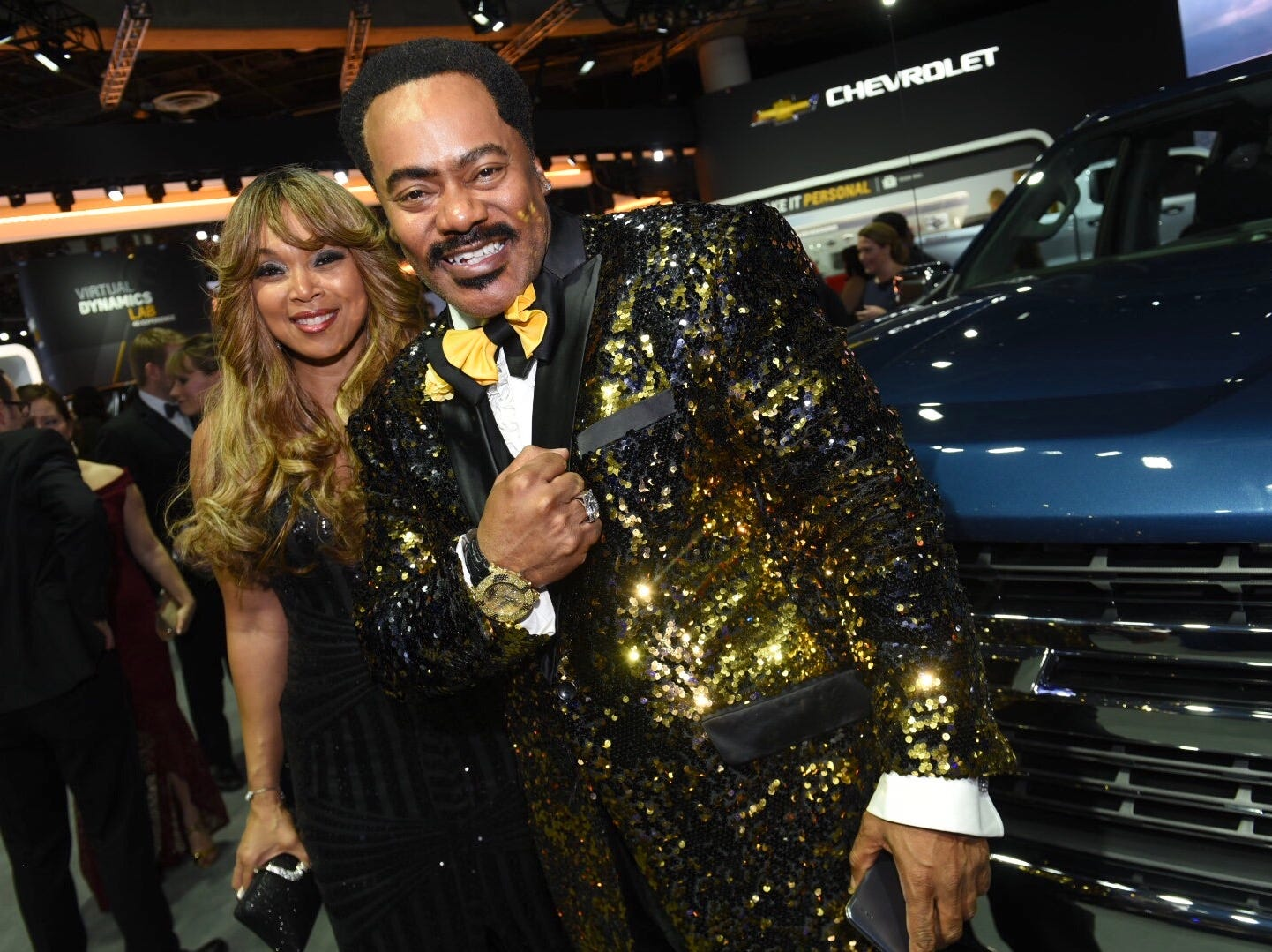 Thomas J. Bolden shines with his golden sport coat and his date, Cassandra Frederick of Detroit, in the Chevy exhibit area.