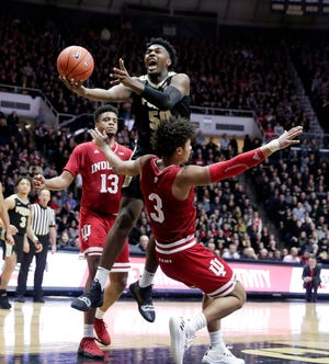 Purdue forward Trevion Williams (50) is fouled by Indiana forward Justin Smith (3) as he shoots during the second half Saturday. Purdue defeated Indiana 70-55.