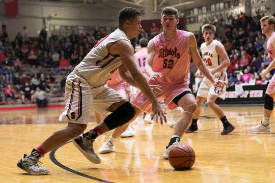 Southridge's Jaden Hayes attempts to run the ball past Heritage Hills' Blake Sisley during Friday's boys basketball game in Huntingburg. Heritage Hills defeated Southridge 64-52. Daniel Vasta/The Herald