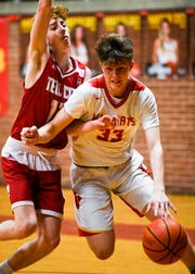 Mater Dei's Jackson Hiester (33) drives against defense from Tell City's Trent Arnold (12) as the Mater Dei Wildcats play the Tell City Marksmen at Mater Dei Friday, January 18, 2019.