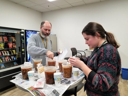 Courier & Press photographers Denny Simmons and Sam Owens enjoy our hot and sour soup blind tasting.
