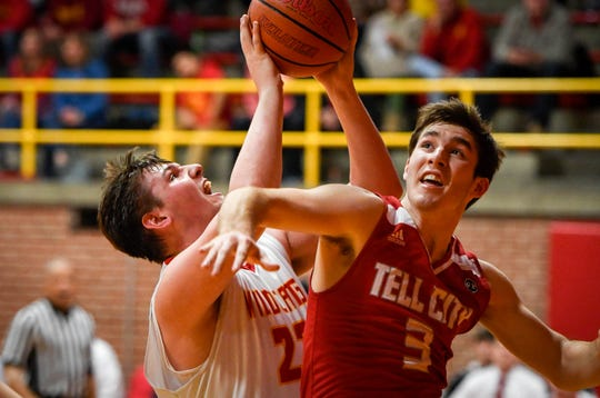 Mater Dei's Logan Carter (23) in fouled by Tell City's Tretter Lyons (3) as the Mater Dei Wildcats play the Tell City Marksmen at Mater Dei Friday, January 18, 2019.