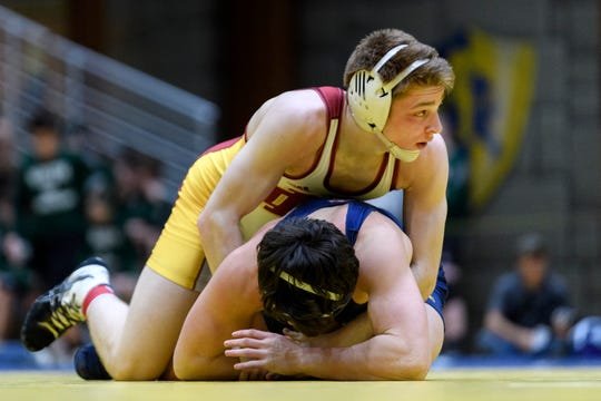 Mater Dei's Matthew Lee competes against Castle's Brooks Hartz during the 145 lb. weight class championship match at the 63rd annual SIAC wrestling tournament held at Castle High School in Newburgh, Ind., Saturday, Jan. 19, 2019. Lee defeated Hartz to claim first place.