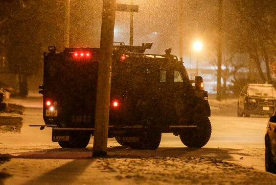 The Fond du Lac Police Department SWAT vehicle stages at a reported hostage situation Friday, January 18, 2019 at Third Street and Ellis Street in the City of Fond du Lac. After making contact with the occupants of the reported house, it was determined that the 911 call reporting the situation was a false report. Doug Raflik/USA TODAY NETWORK-Wisconsin
