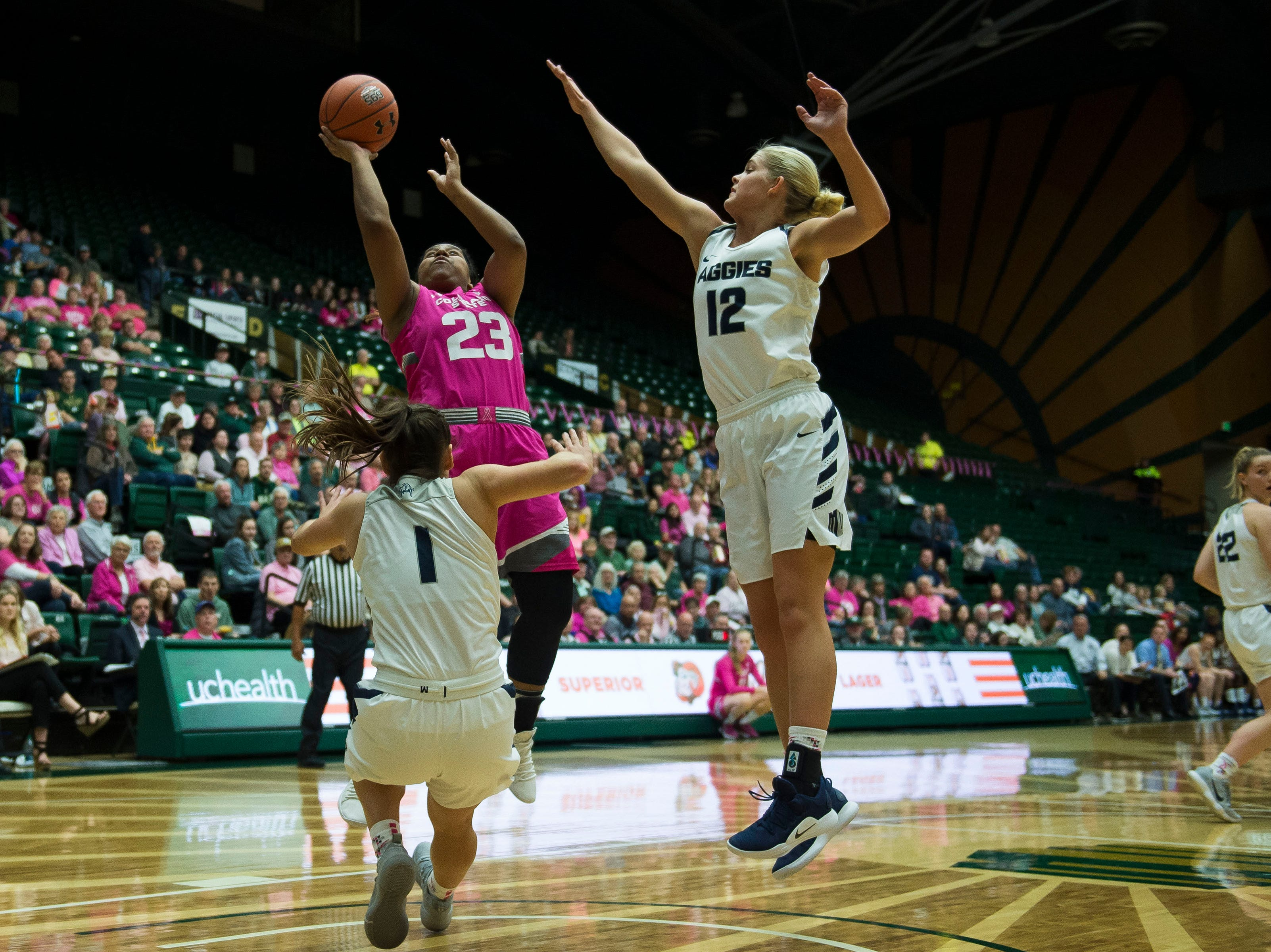Colorado State University sophomore guard Grace Colaivalu (23) takes a shot past Utah State defenders on Saturday, Jan. 19, 2019, at Moby Arena in Fort Collins, Colo.