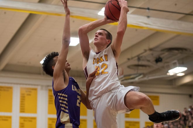 Rocky Mountain High School's Kenan Schuler puts up a shot over Fort Collins' Dante Smith during a game Jan. 18. Both teams will play home games Tuesday night at 6:30 p.m., with Rocky Mountain hosting Fairview and Fort Collins entertaining Mountain Range.