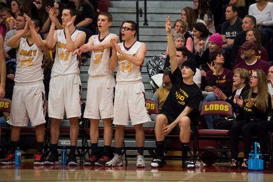 The Rocky Mountain High School bench reacts to a three-pointer against rival Fort Collins High School on Friday, Jan. 18, 2019, at Rocky Mountain High School in Fort Collins, Colo.