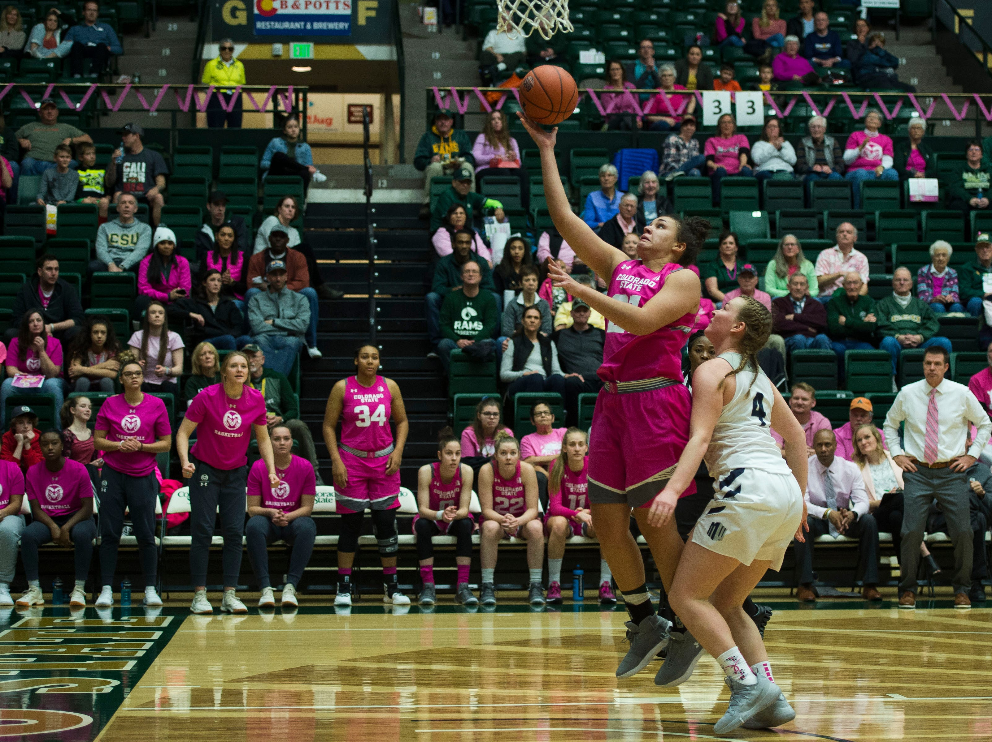 Colorado State University senior guard Myanne Hamm (21) goes for a layup after stealing the ball from Utah State freshman guard Steph Gorman (4) on Saturday, Jan. 19, 2019, at Moby Arena in Fort Collins, Colo.