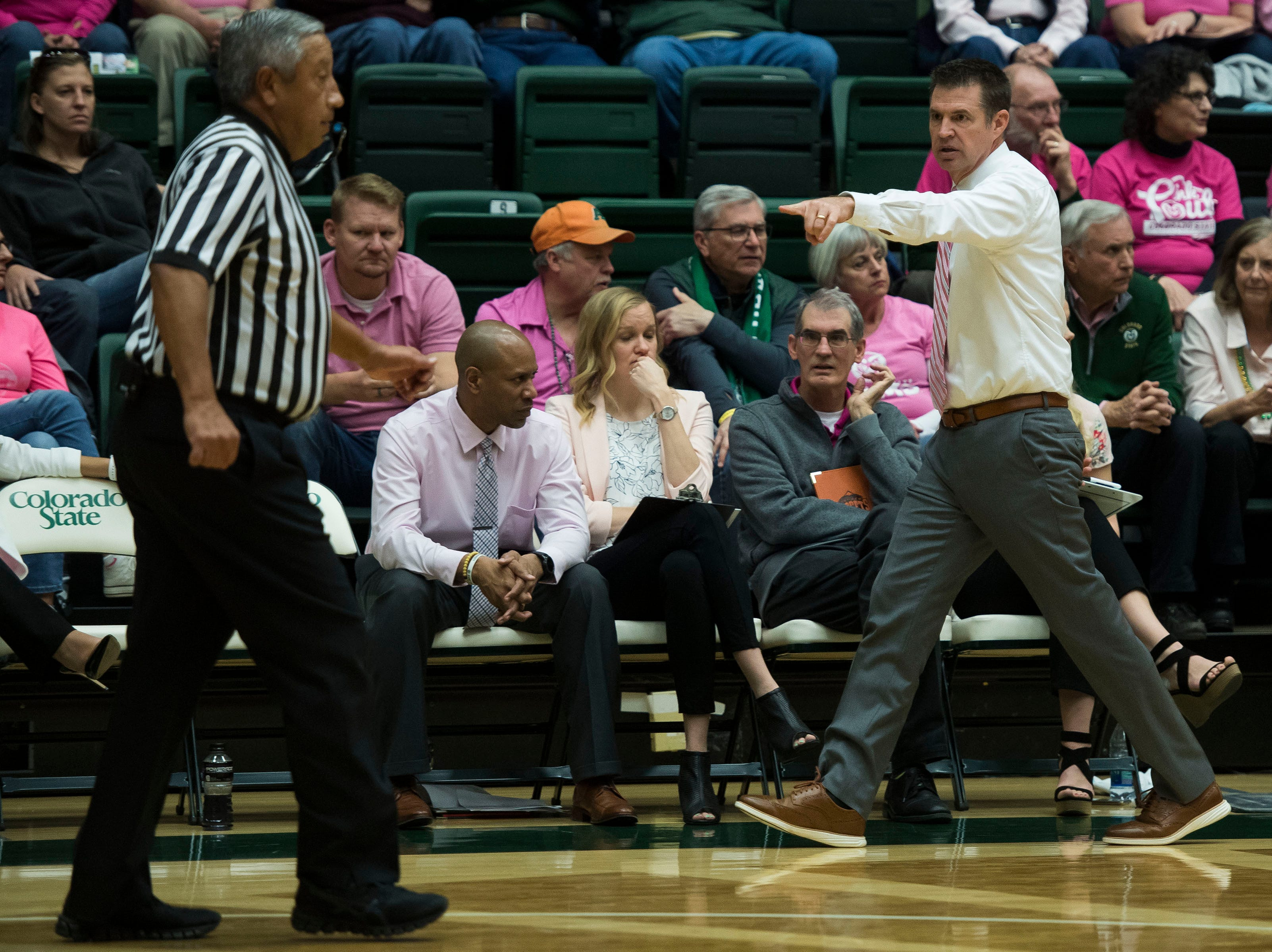 Colorado State University head coach Ryun Williams talks to an official during a game against Utah State on Saturday, Jan. 19, 2019, at Moby Arena in Fort Collins, Colo.