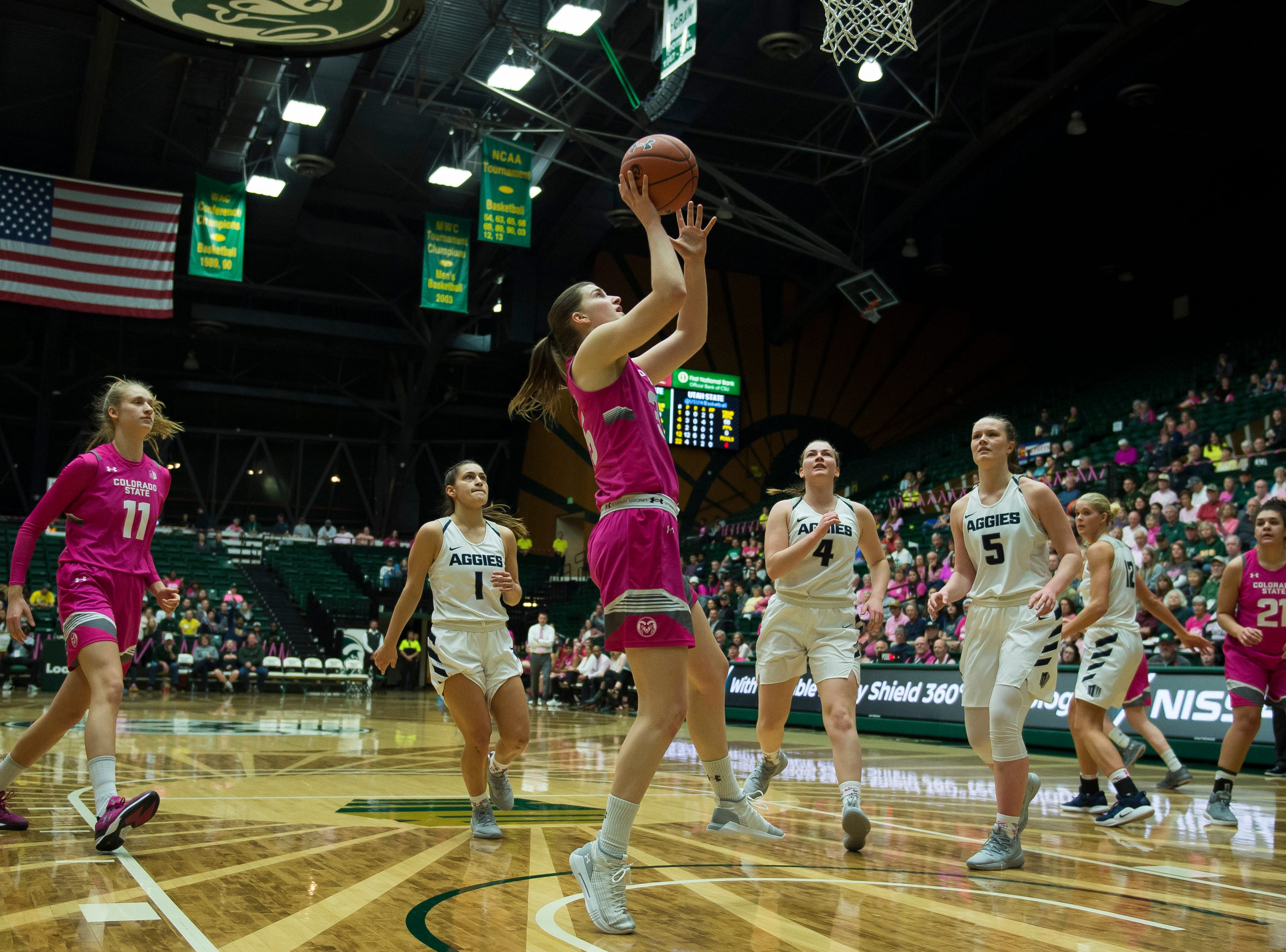 Colorado State University sophomore guard Lore Devos (35) gets past Utah State defenders for an easy layup on Saturday, Jan. 19, 2019, at Moby Arena in Fort Collins, Colo.
