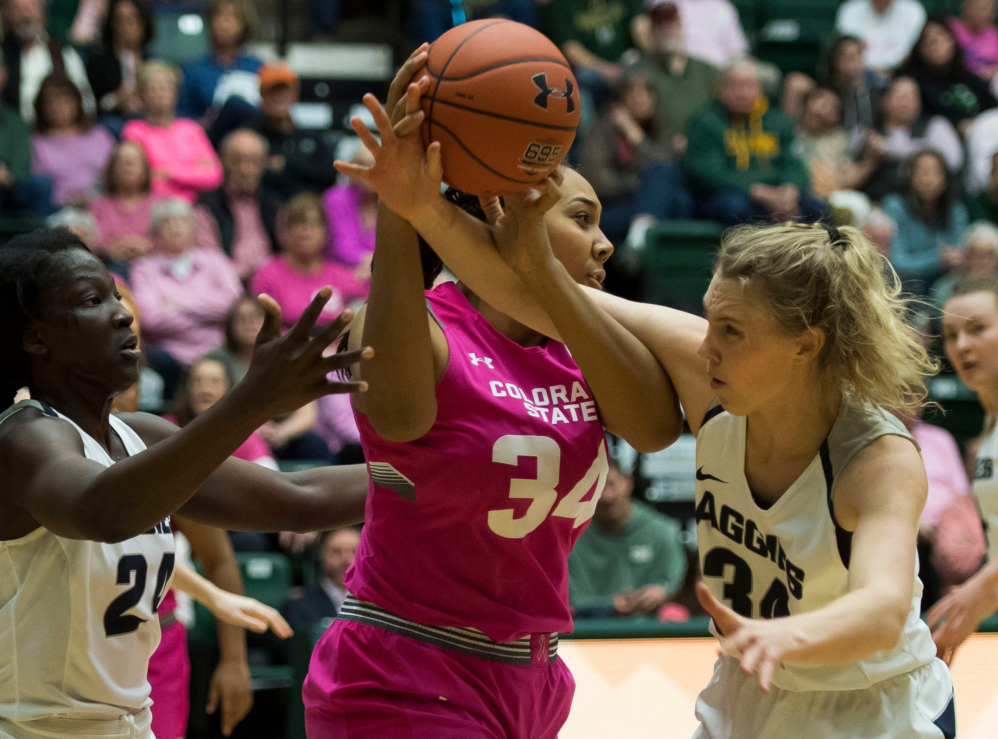 Colorado State University sophomore center Liah Davis (34) is fouled by Utah State freshman forward Emma Dudley (34) on Saturday, Jan. 19, 2019, at Moby Arena in Fort Collins, Colo.