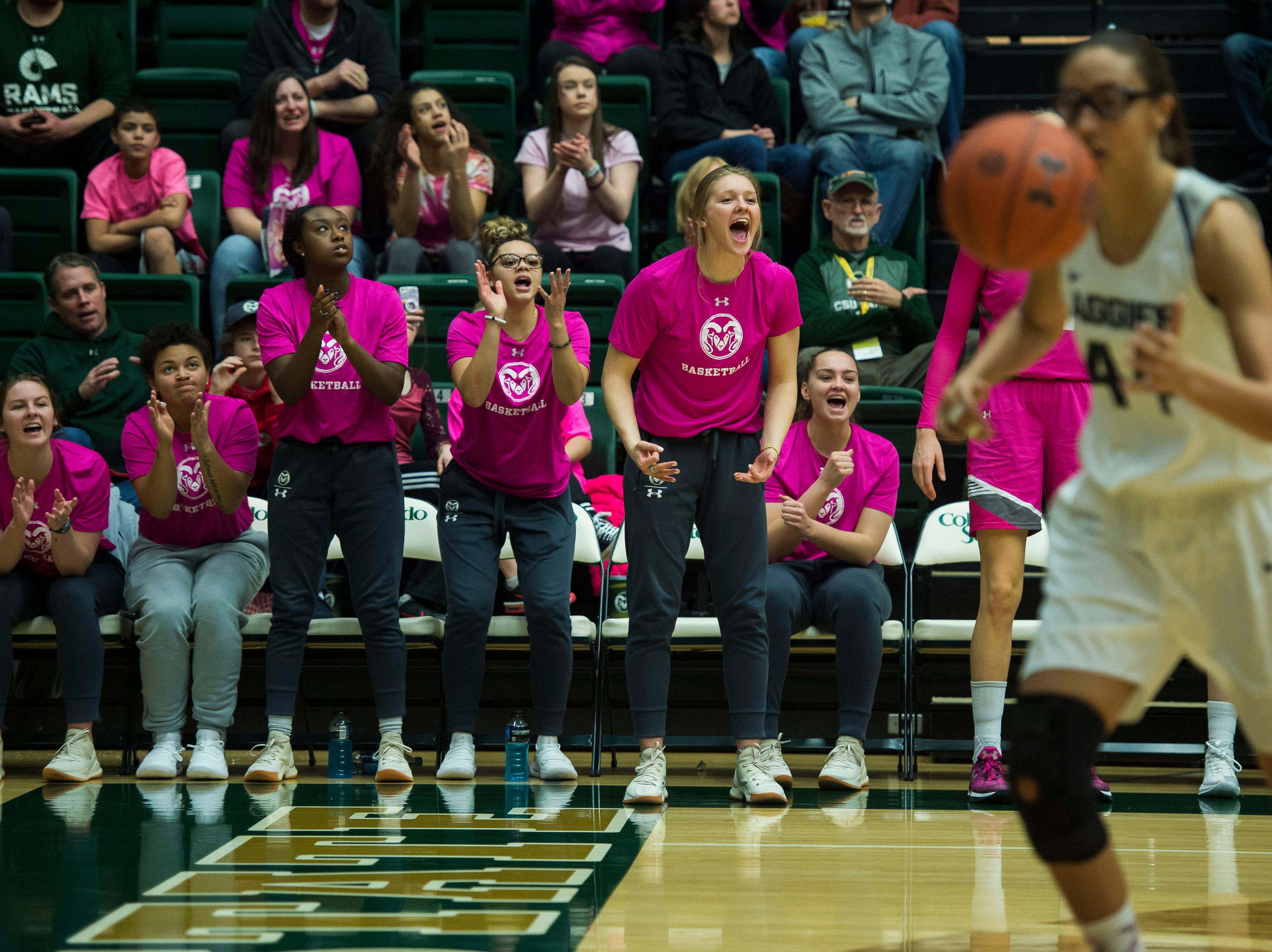Recent Colorado State University transfers cheer their team on during a game against Utah State on Saturday, Jan. 19, 2019, at Moby Arena in Fort Collins, Colo.