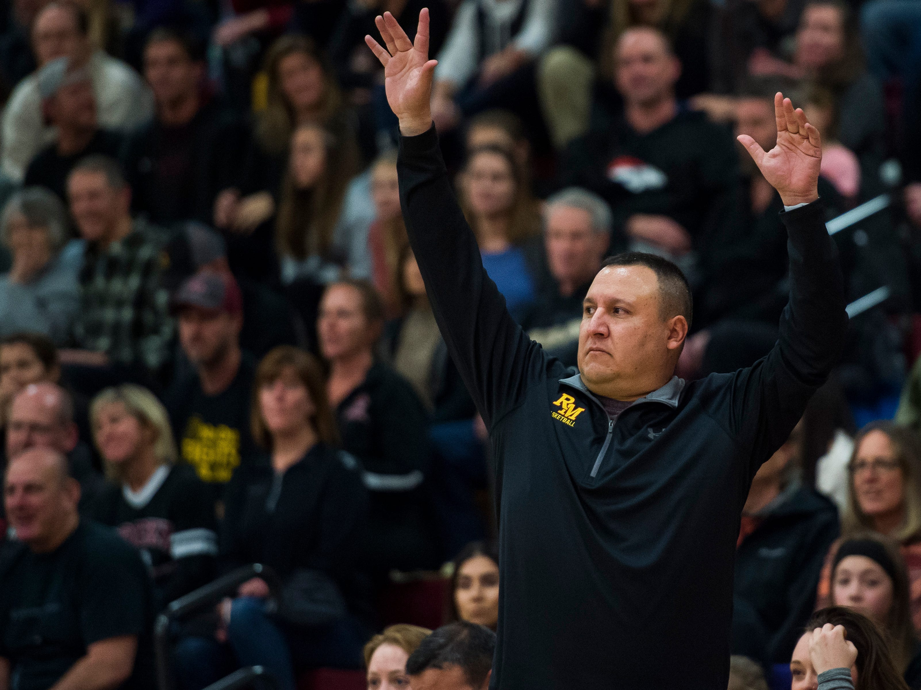 Rocky Mountain High School head girls basketball coach Justin Vallejo gives good vibes while a player attempts a free throw during a game against Fort Collins High School on Friday, Jan. 18, 2019, at Rocky Mountain High School in Fort Collins, Colo.