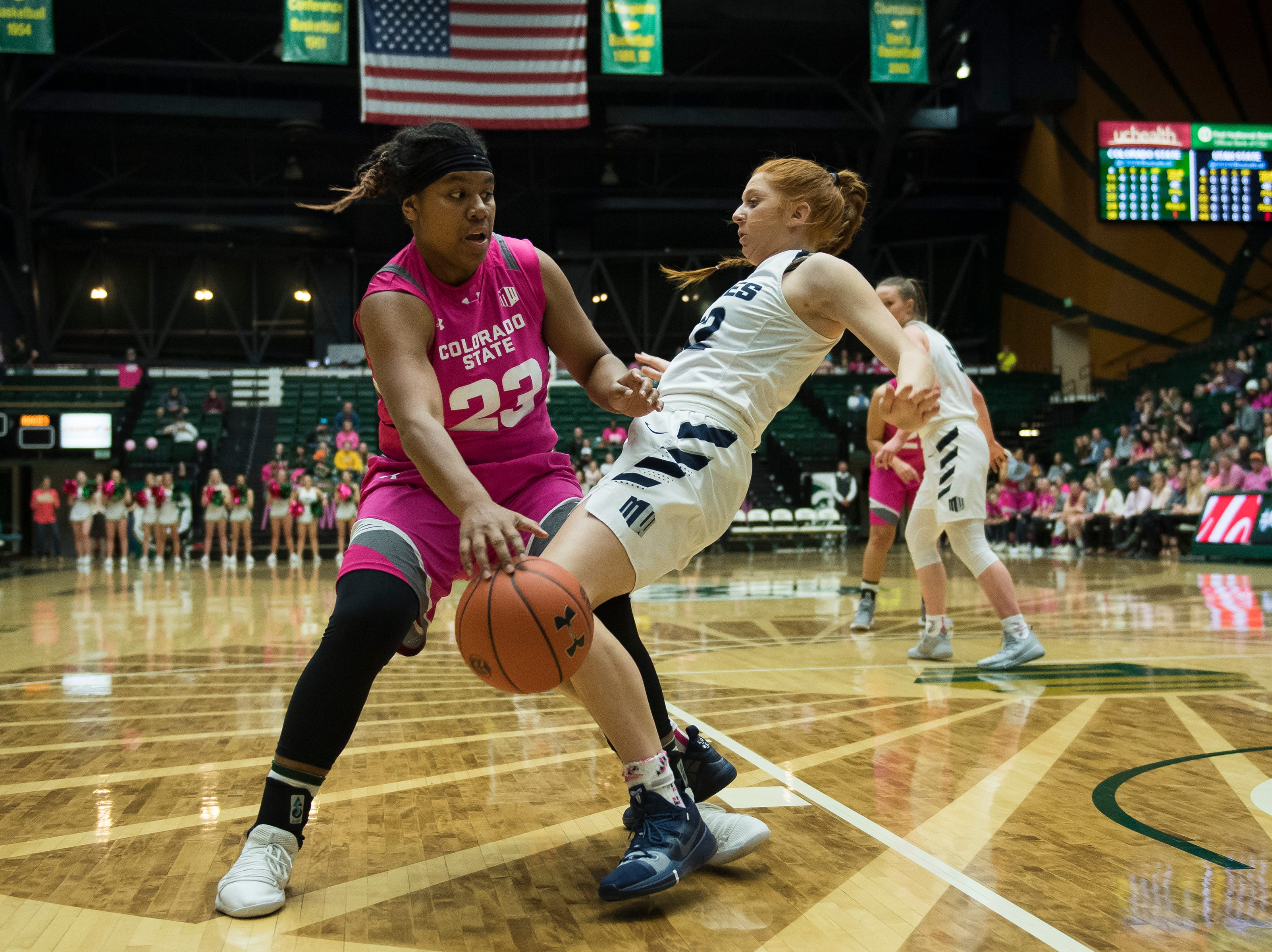 Colorado State University sophomore guard Grace Colaivalu (23) fouls Utah State sophomore guard Emma Harris (32) on Saturday, Jan. 19, 2019, at Moby Arena in Fort Collins, Colo.