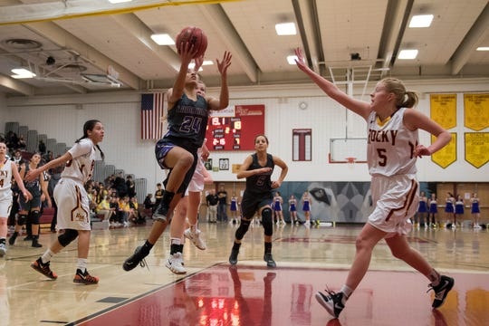Both the Rocky Mountain and Fort Collins girls basketball teams, shown in a file photo, lost their first-round playoff games on Tuesday. Poudre also lost a first-round game.