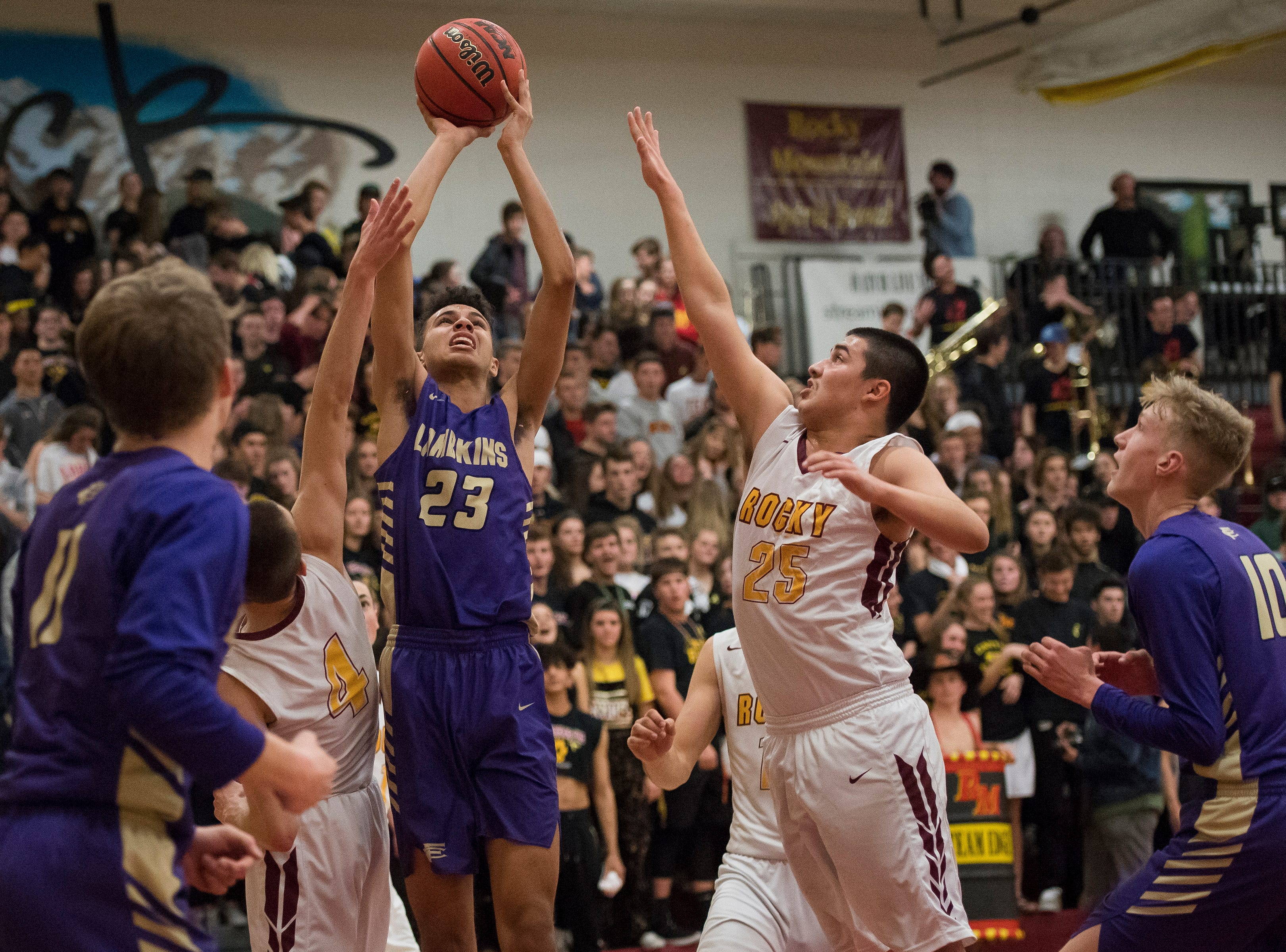 Fort Collins High School sophomore Danté Smith (23) takes a shot during a game against Rocky Mountain High School on Friday, Jan. 18, 2019, at Rocky Mountain High School in Fort Collins, Colo.