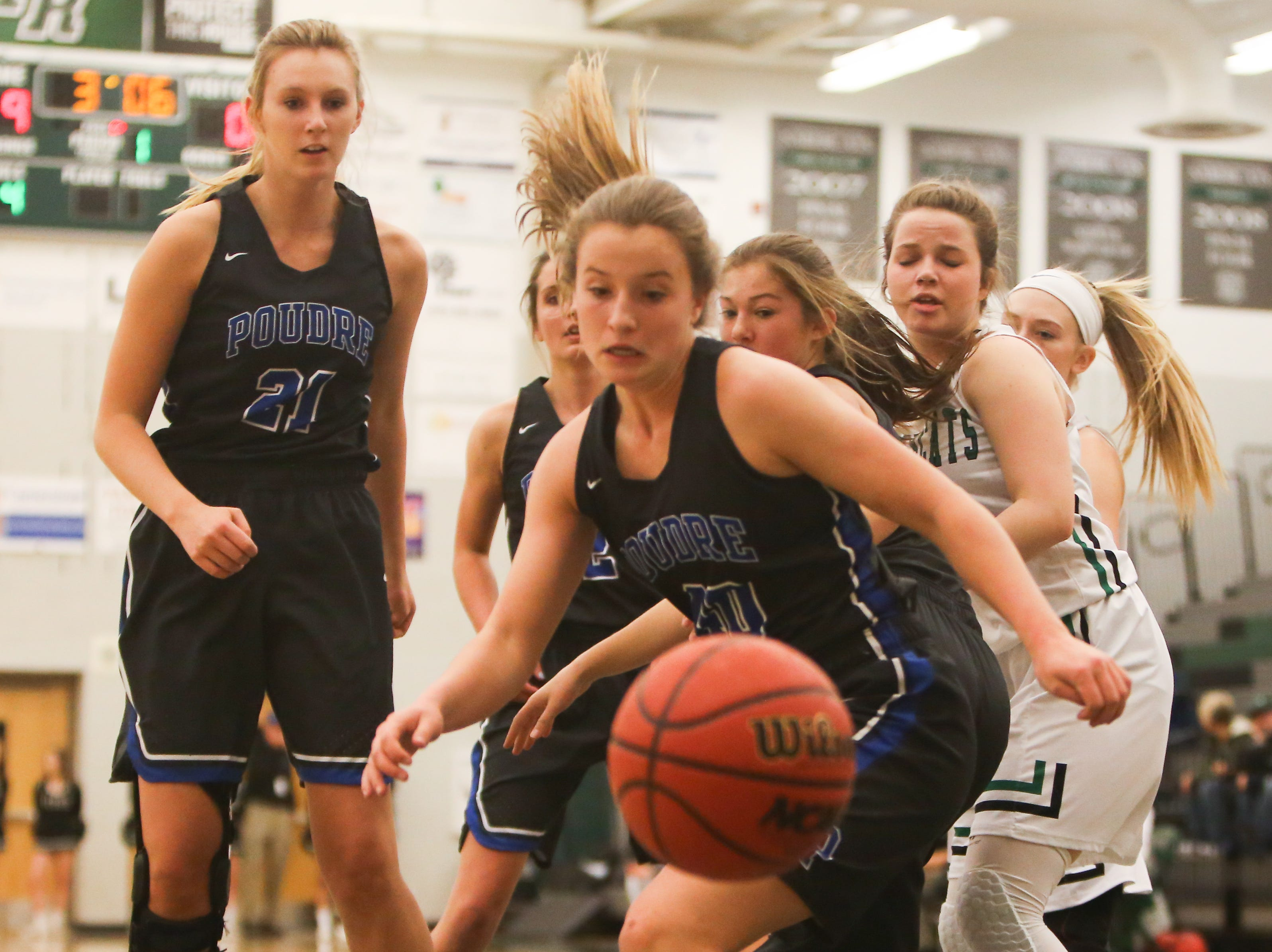 A Poudre High School players loses control against the ball during the game against Fossil Ridge on Jan. 18.